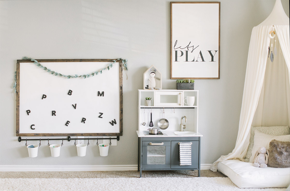 neutral playroom with magnetic board