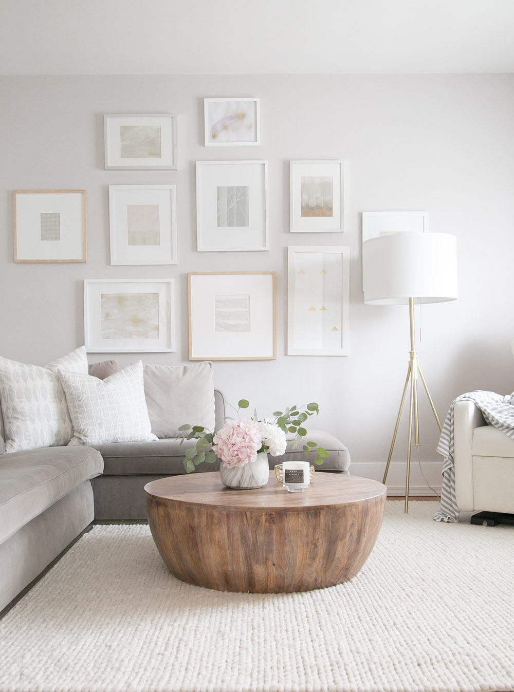 A family friendly living room design with round coffee table by Winter Daisy Interiors