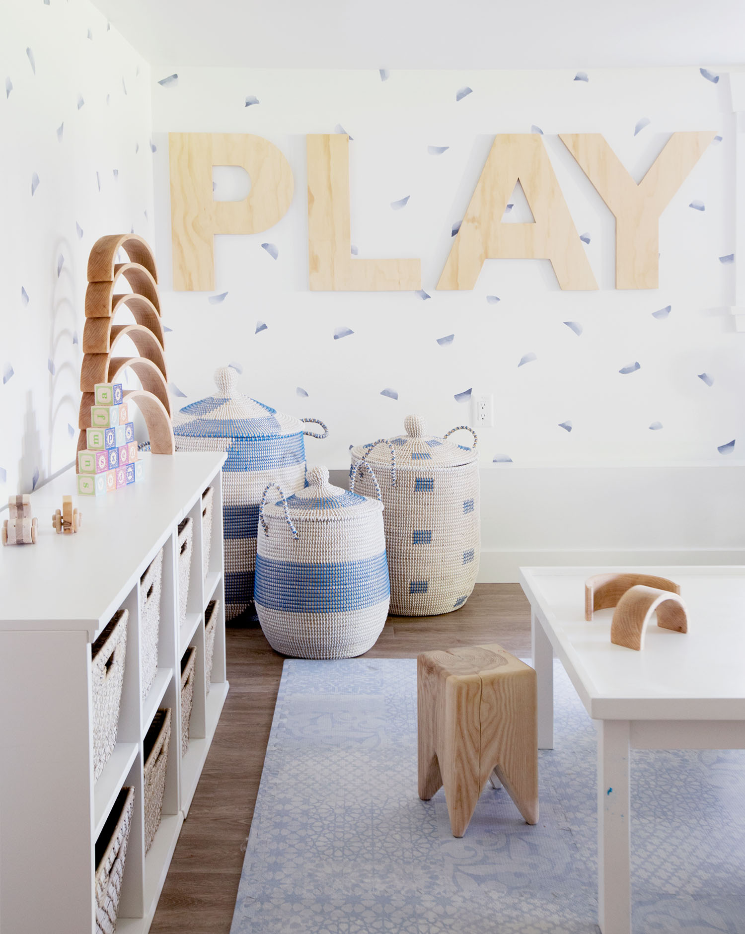 modern playroom with PLAY letters on wall