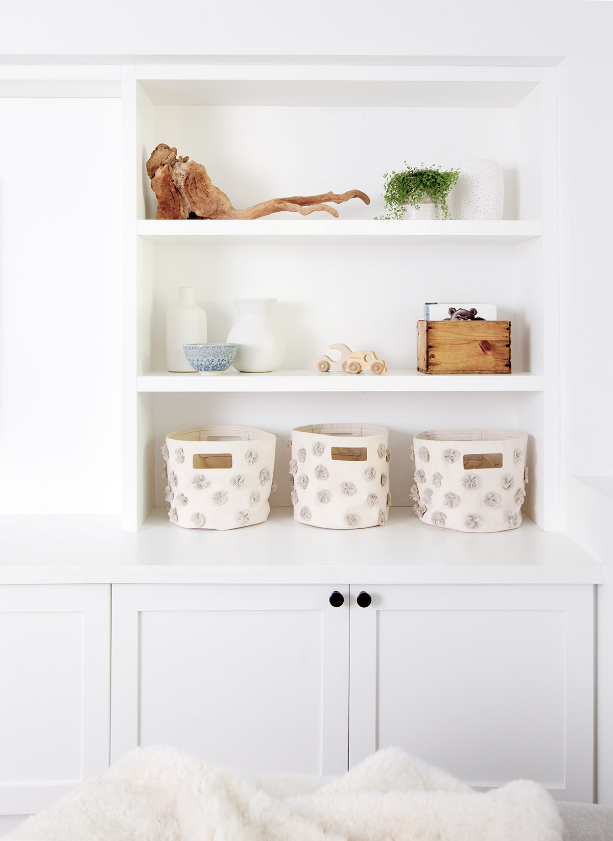playroom shelves with pom pom storage baskets