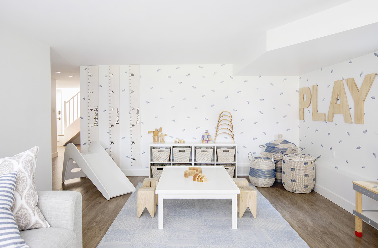 fresh + modern white and blue basement playroom