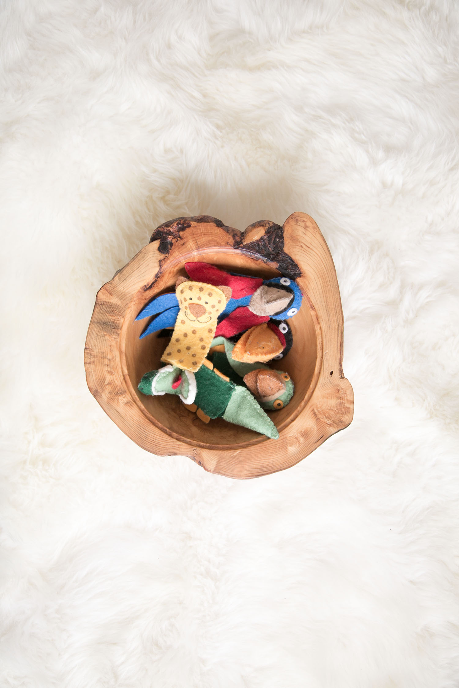 finger puppets in wood bowl