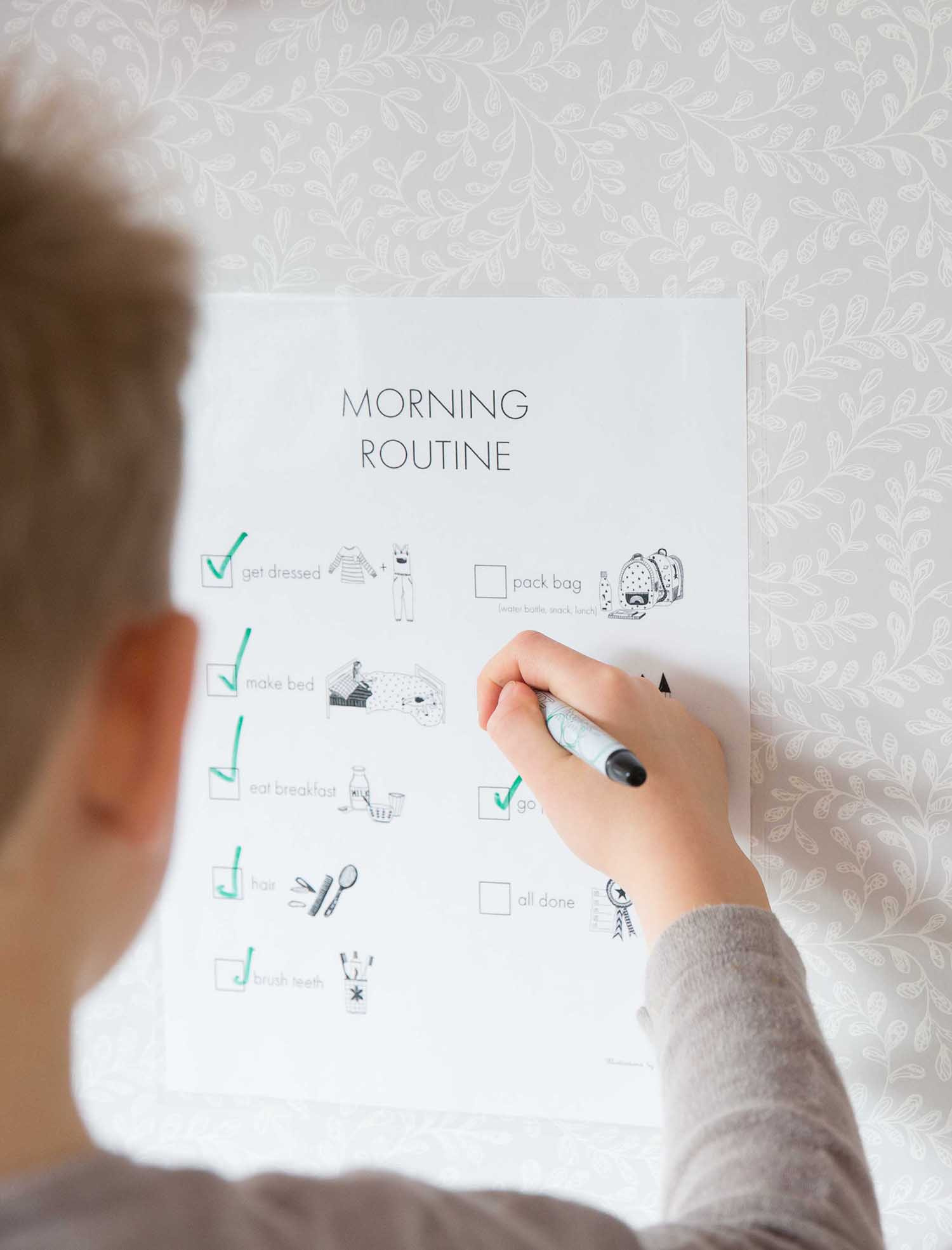 child completing morning routine chart