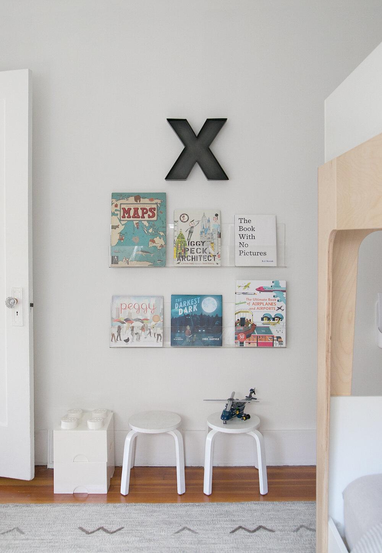 acrylic bookshelves in boy room