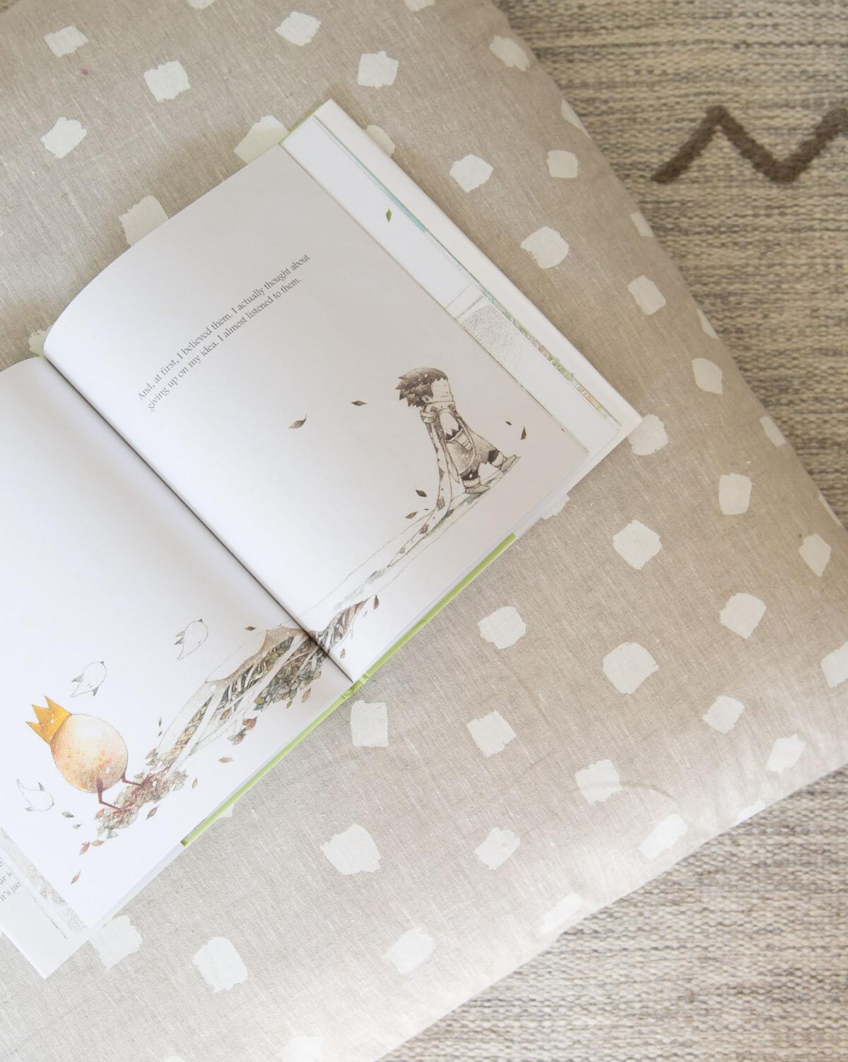 natti natti floor pillow with book