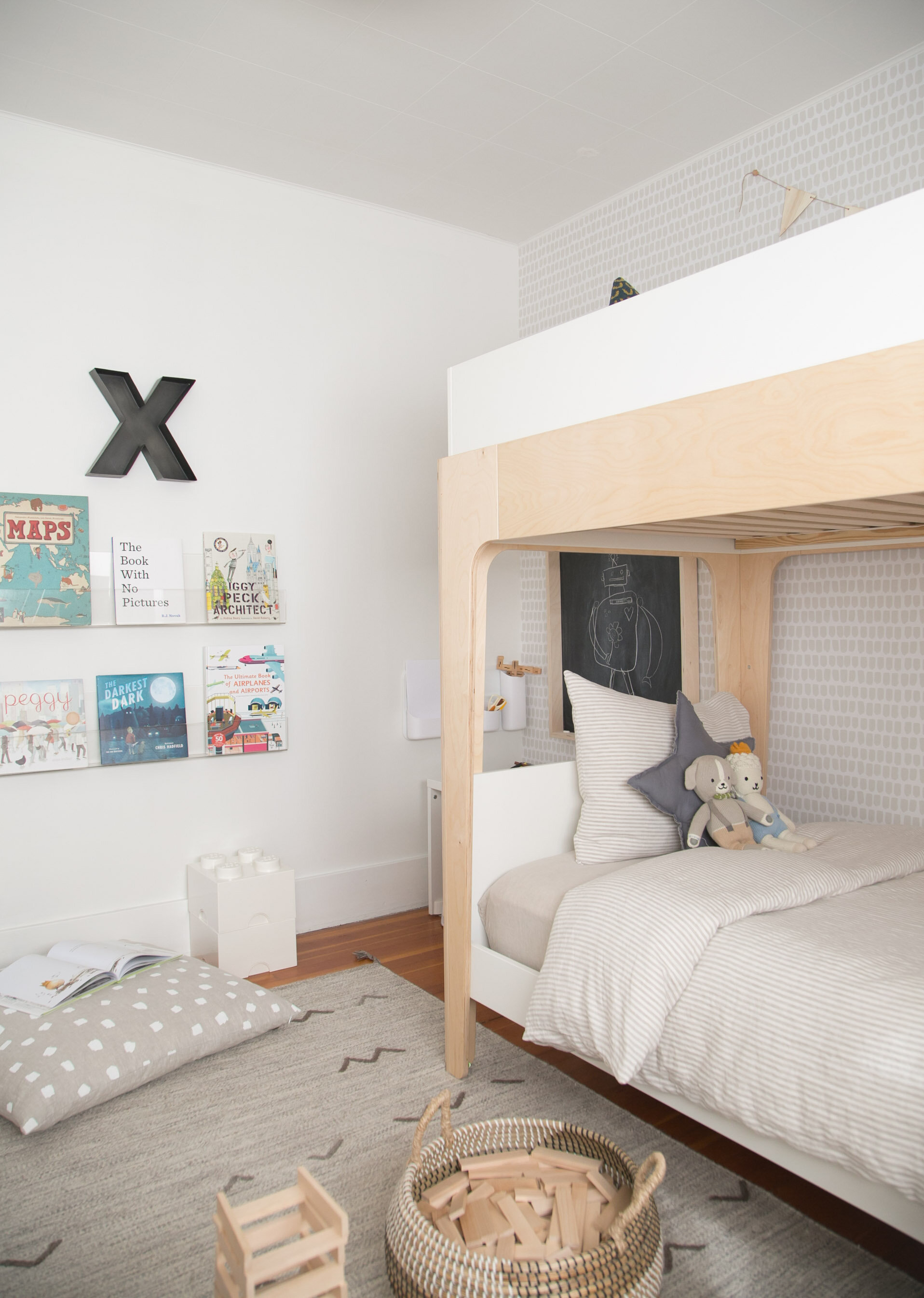 book wall and bunk bed in boy room