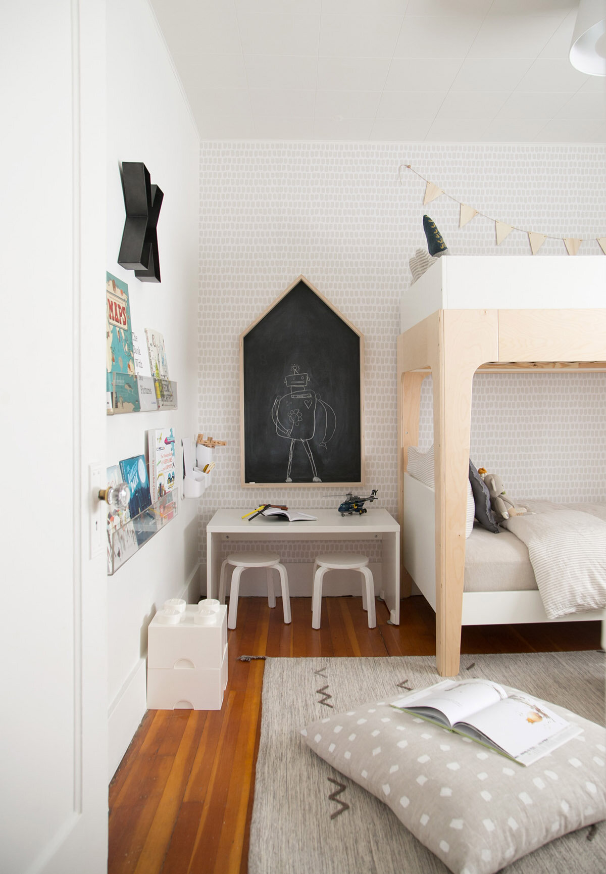 neutral kids room with house shaped chalkboard and bunk bed