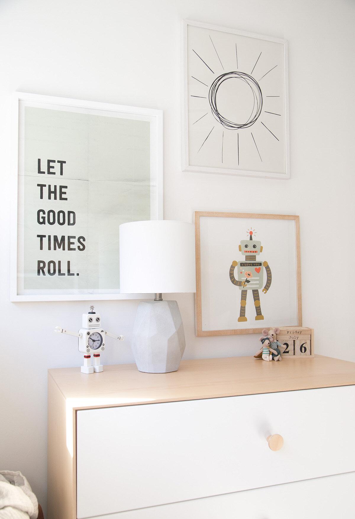 gallery wall over dresser in children's bedroom