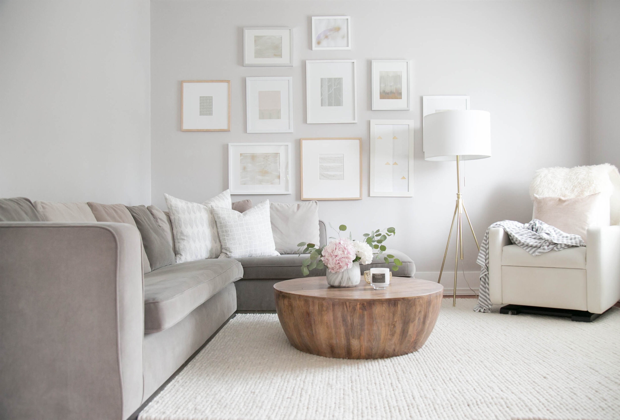 round wood coffee table in neutral living room