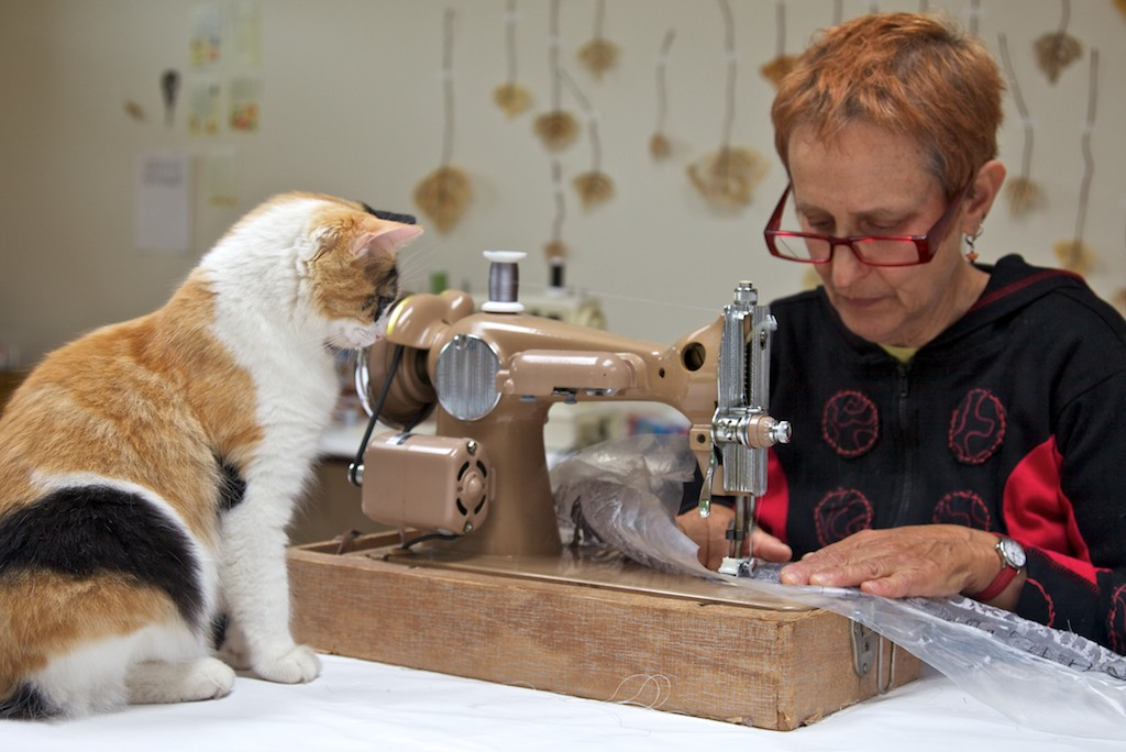 Lisa Kokin, mixed media artist, teaching Bindi how to sew (Image: Lia Roozendaal)
