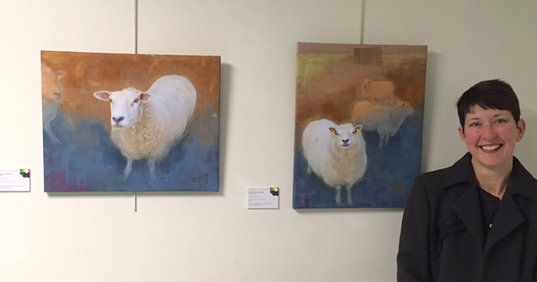 Time and Place  exhibition at the RUH.  Blink and You'll Miss Her  (left) and  But Do You Really See Me?  (right), overpainted photos on canvas. ©2015 Kelly M. O'Brien.