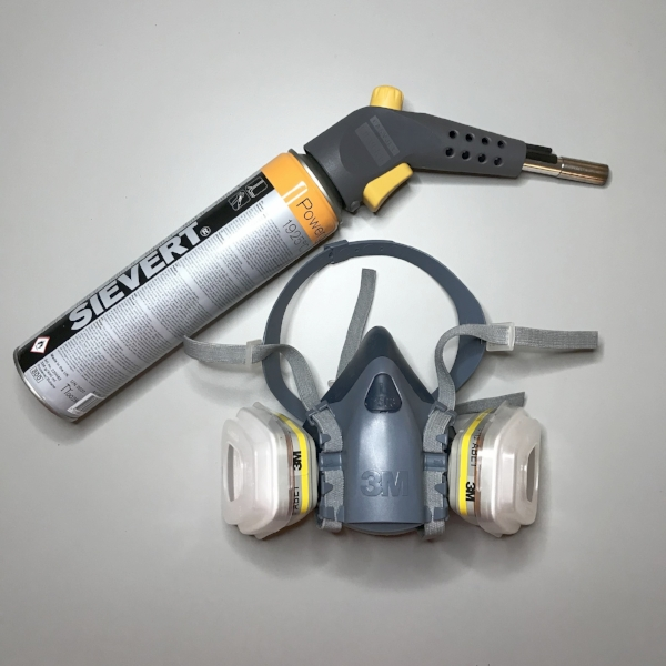 The main tools for my burned paper sculptures. I have the respirator professionally fit-test every year or so to ensure complete protection from smoke, toxins from spray paint, and adhesives. You don't want to mess around when playing with fire - the fire extinguishers and fire blanket should be in this image too! Kelly M. O'Brien ©2018
