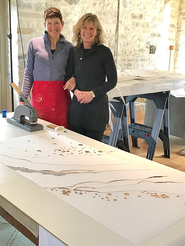Big smiles as we near the end of a large run of variable edition hand-embellished prints. Kelly O'Brien and Pip Falkner-Lee.