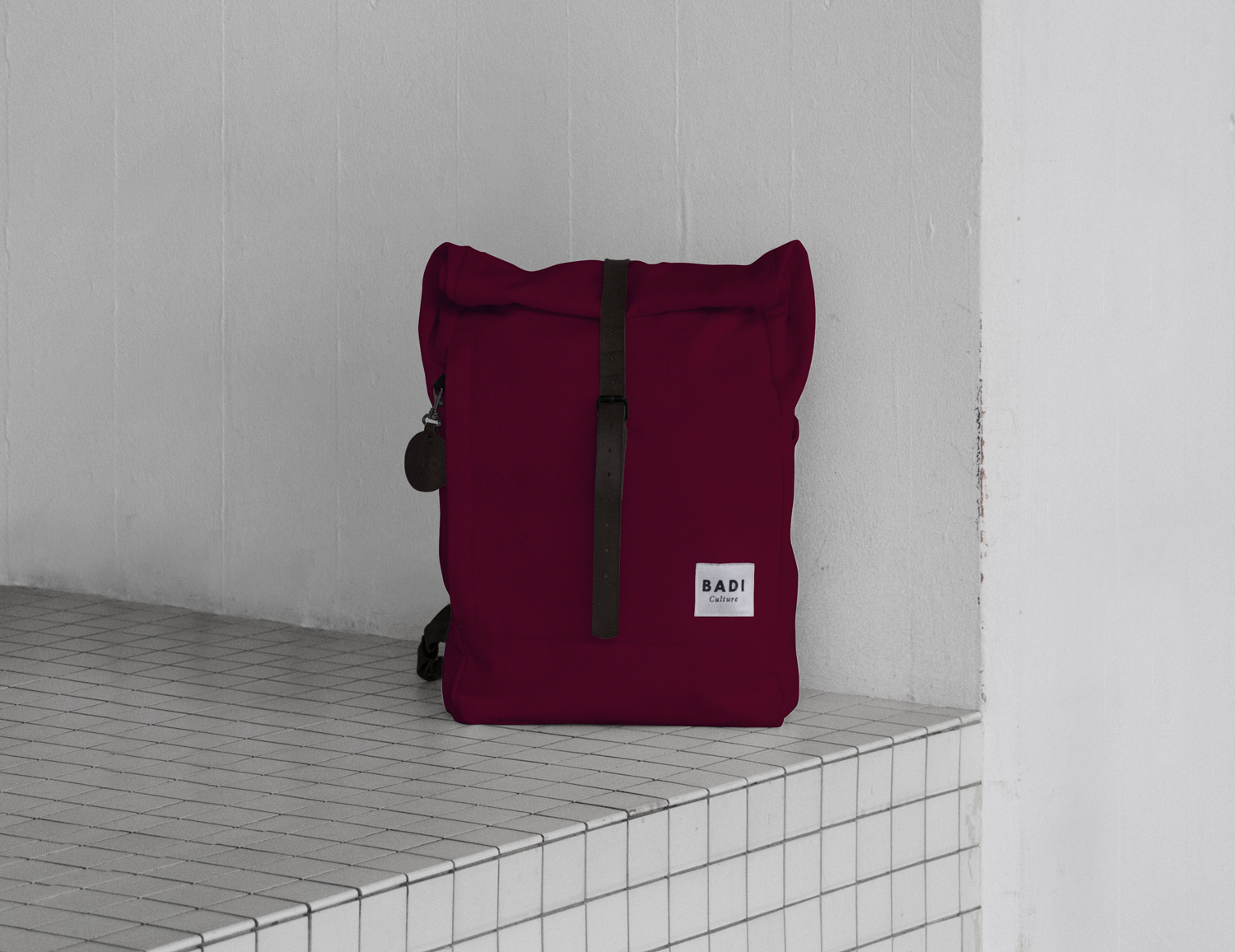 The Roll-Over backpack in bordeaux with black leather