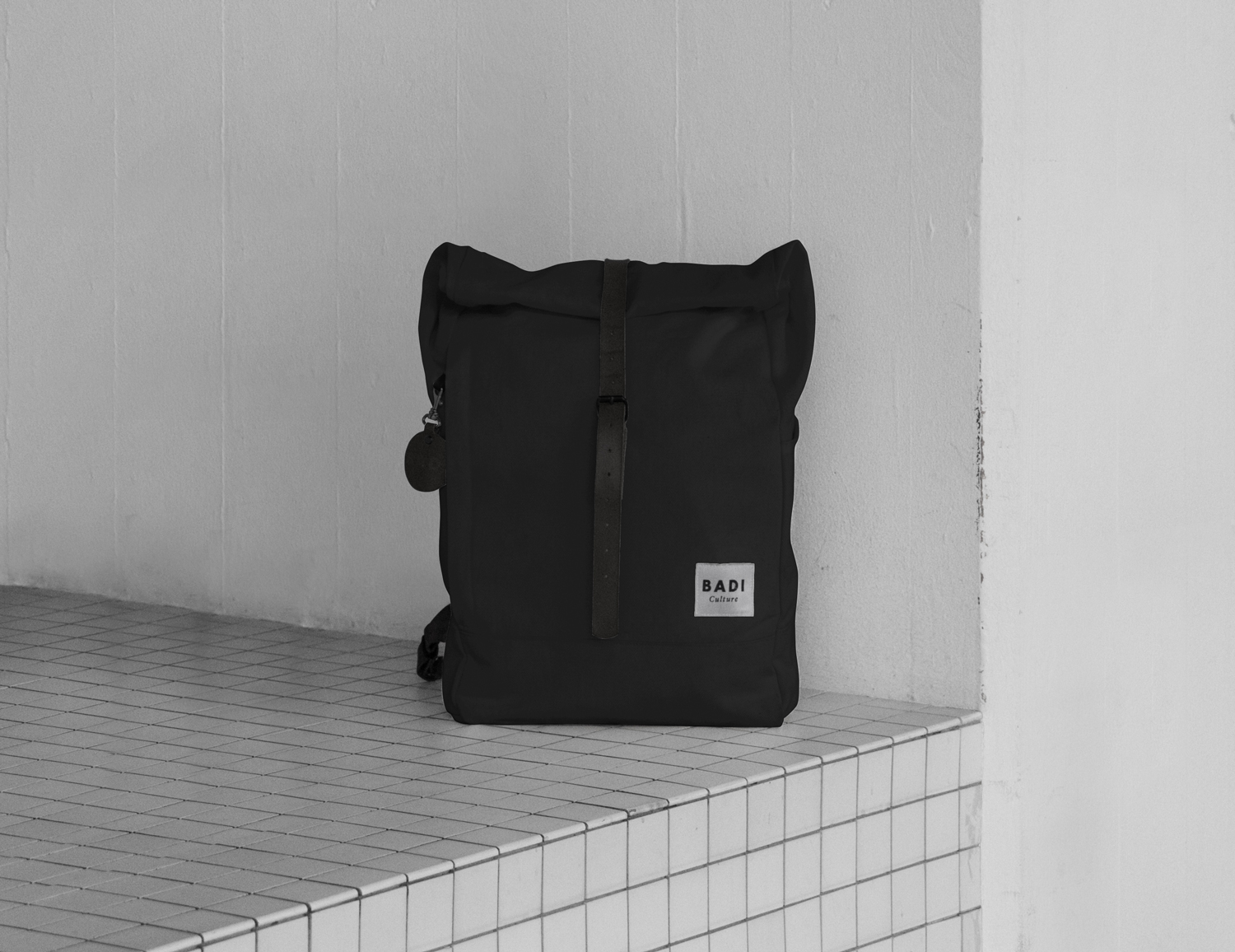 The Roll-Over backpack in black with black leather