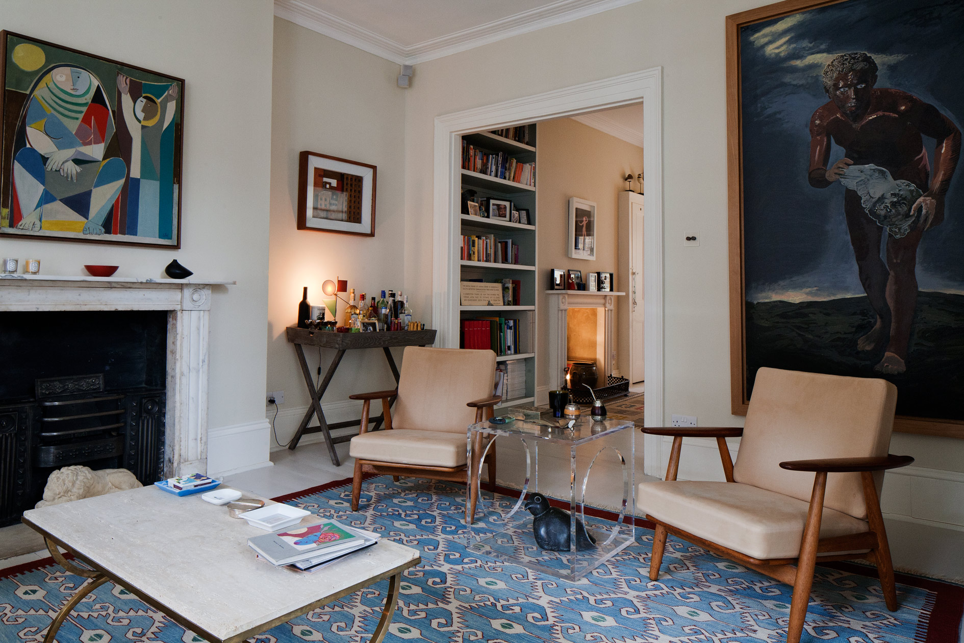 Interiors of bookcases are painted in colours inspired by the adjacent paintings and outside view