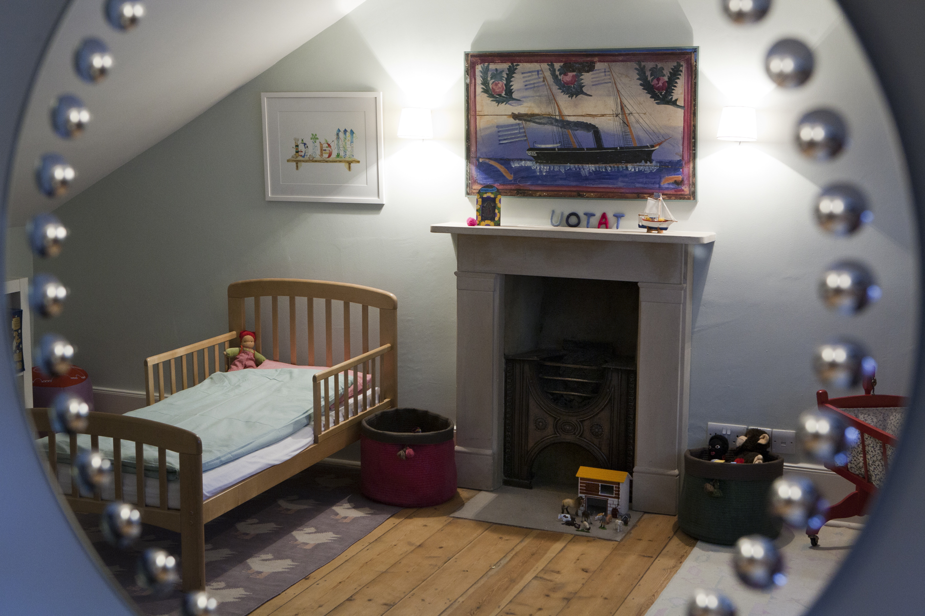 The mirror, originally hung in a bathroom, is a happy addition to the children's room