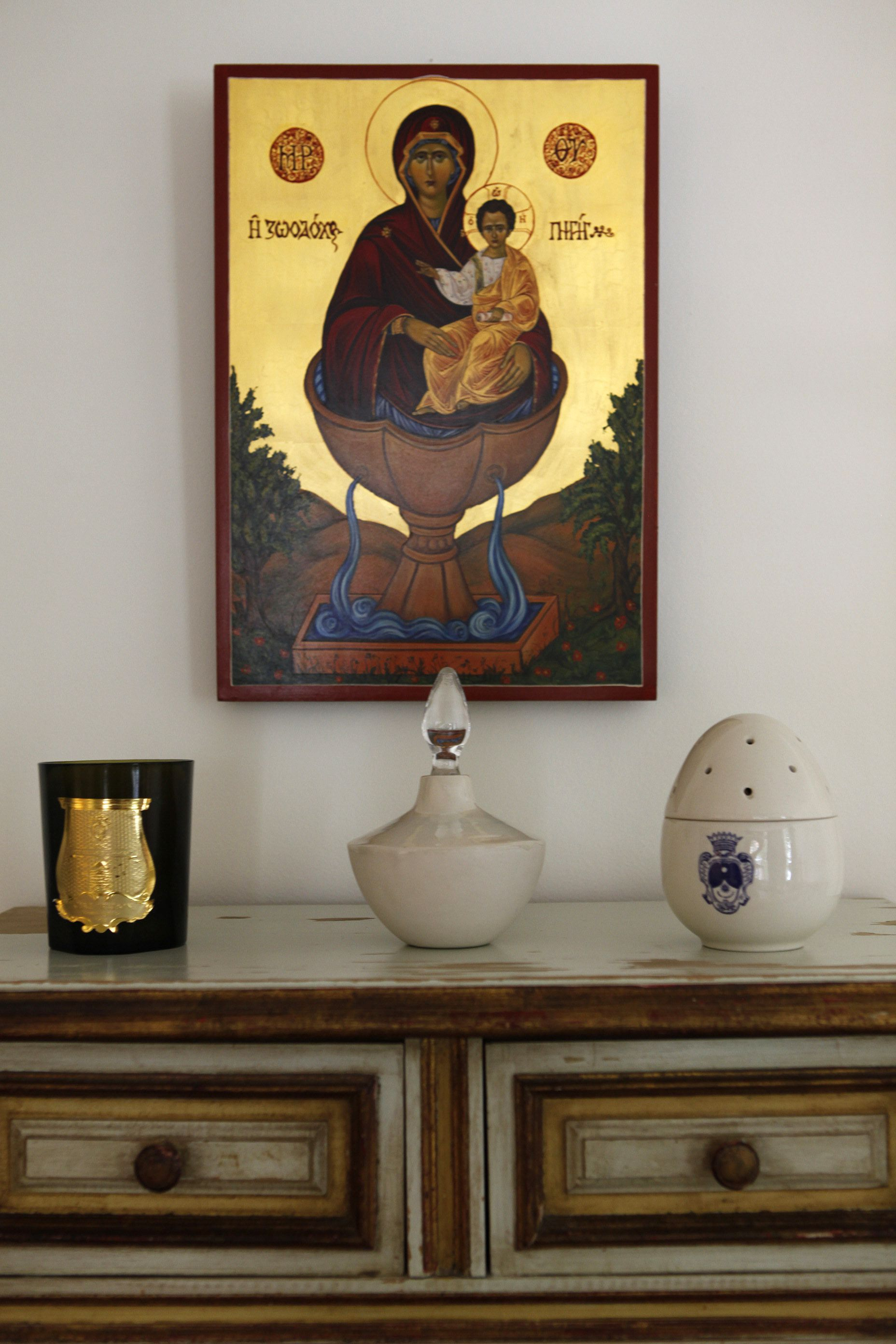 Icon over a painted chest