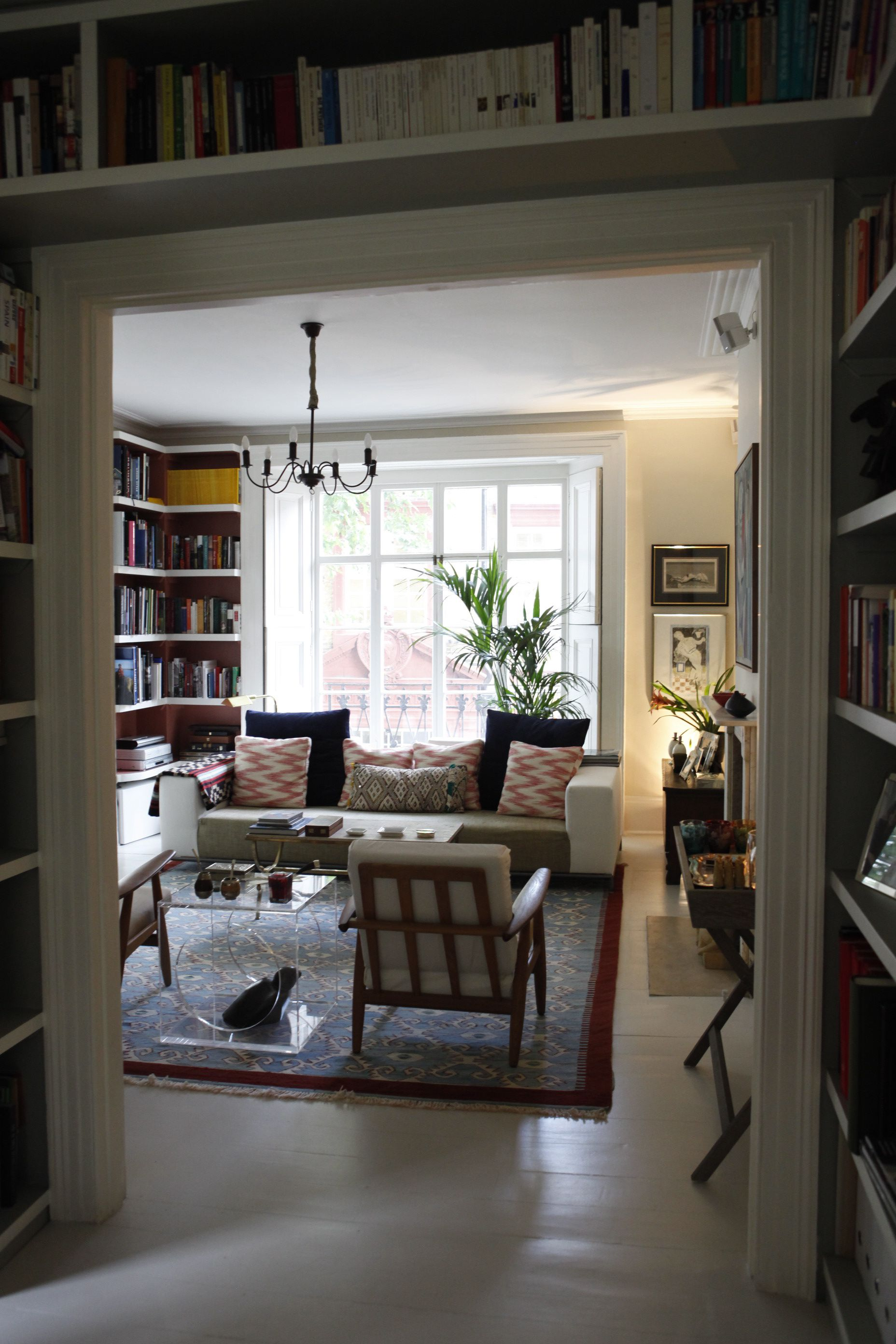 Bookshelves sit above door leading from study