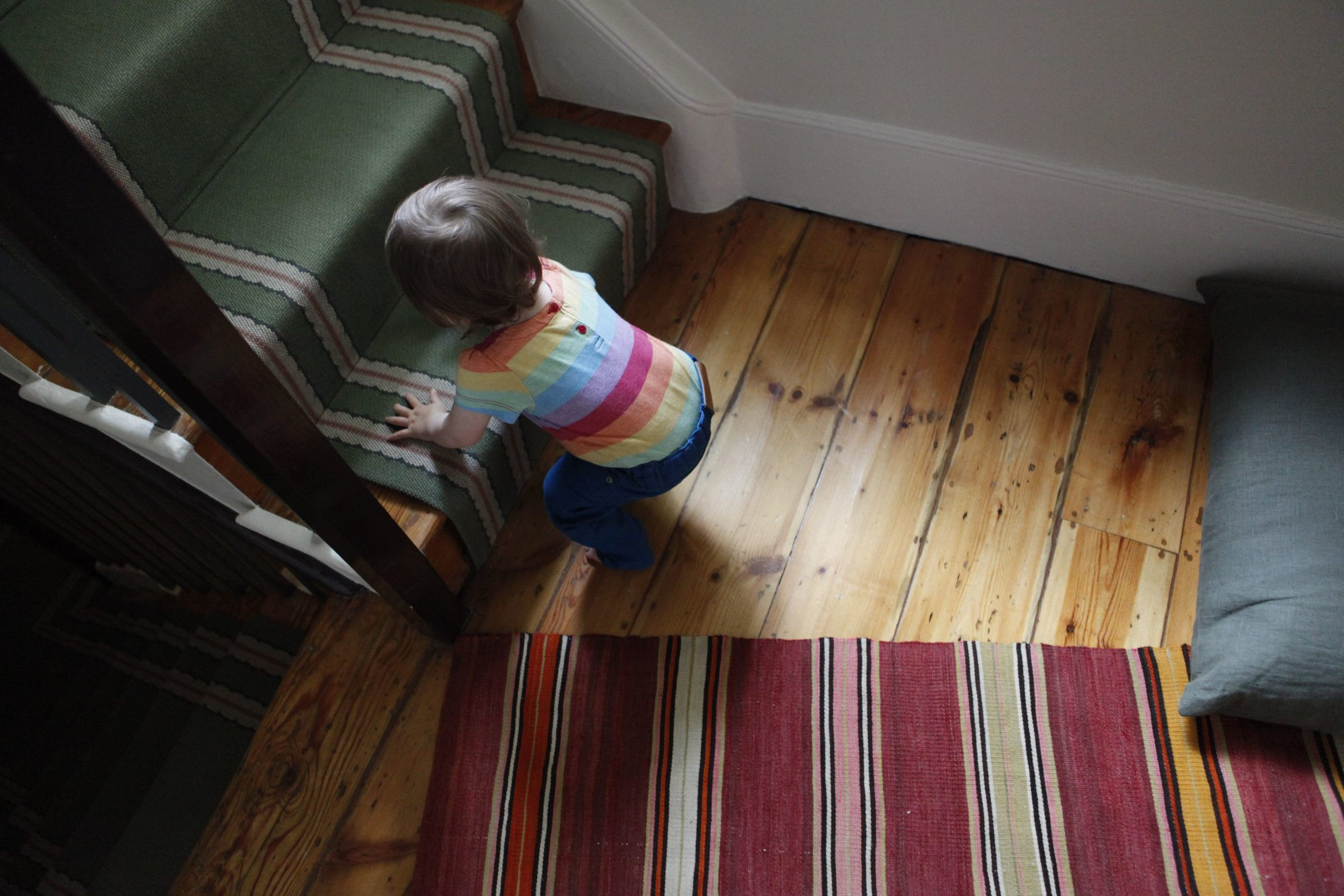 Green stair runner and Moroccan rug