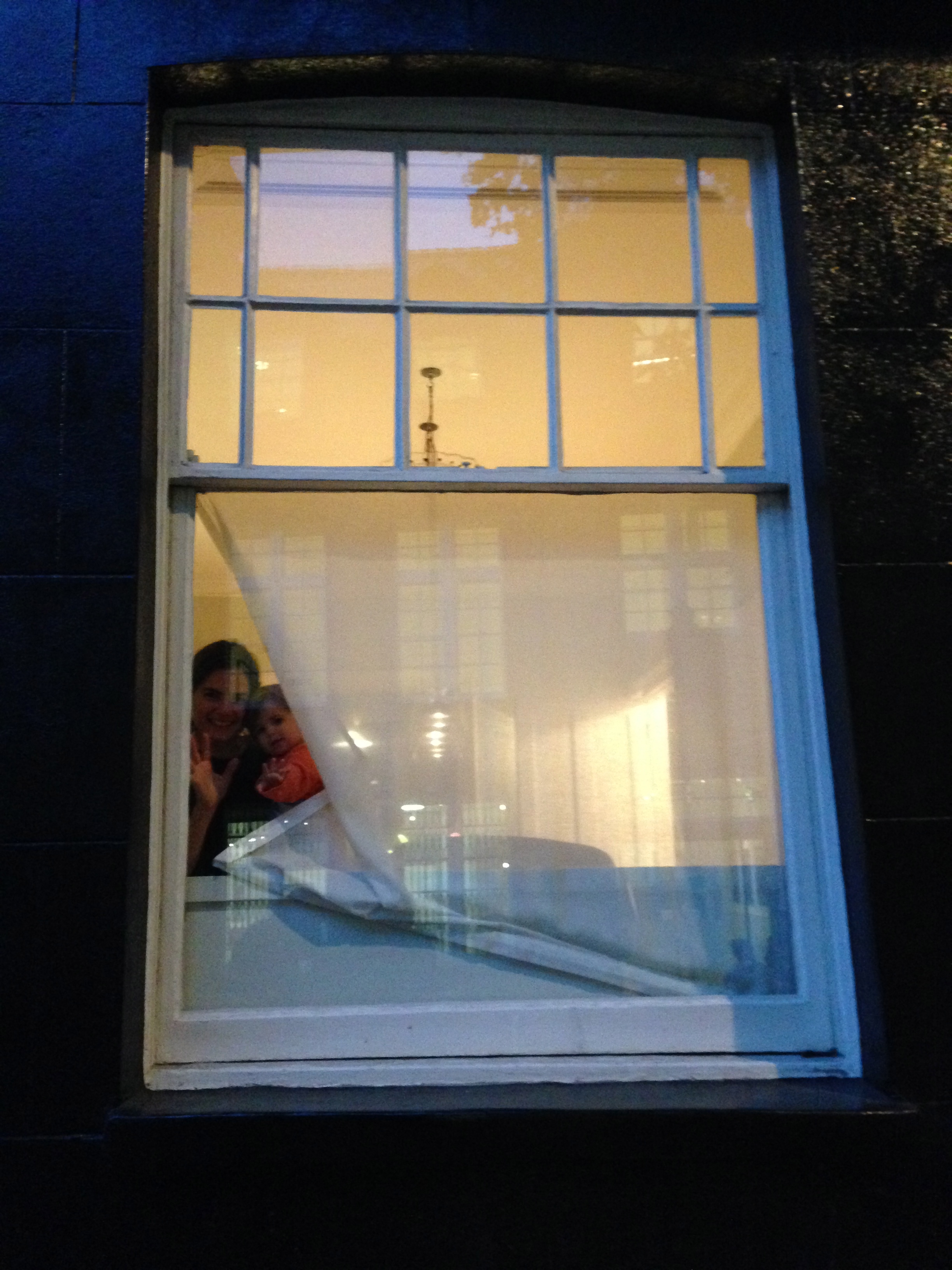Me with my daughter, behind a 'nun's veil' muslin that covers half the window but still let's in lots of light.