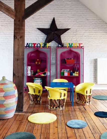 I adore the bright yellow chairs and fuchsiashelves giving this space bags of character