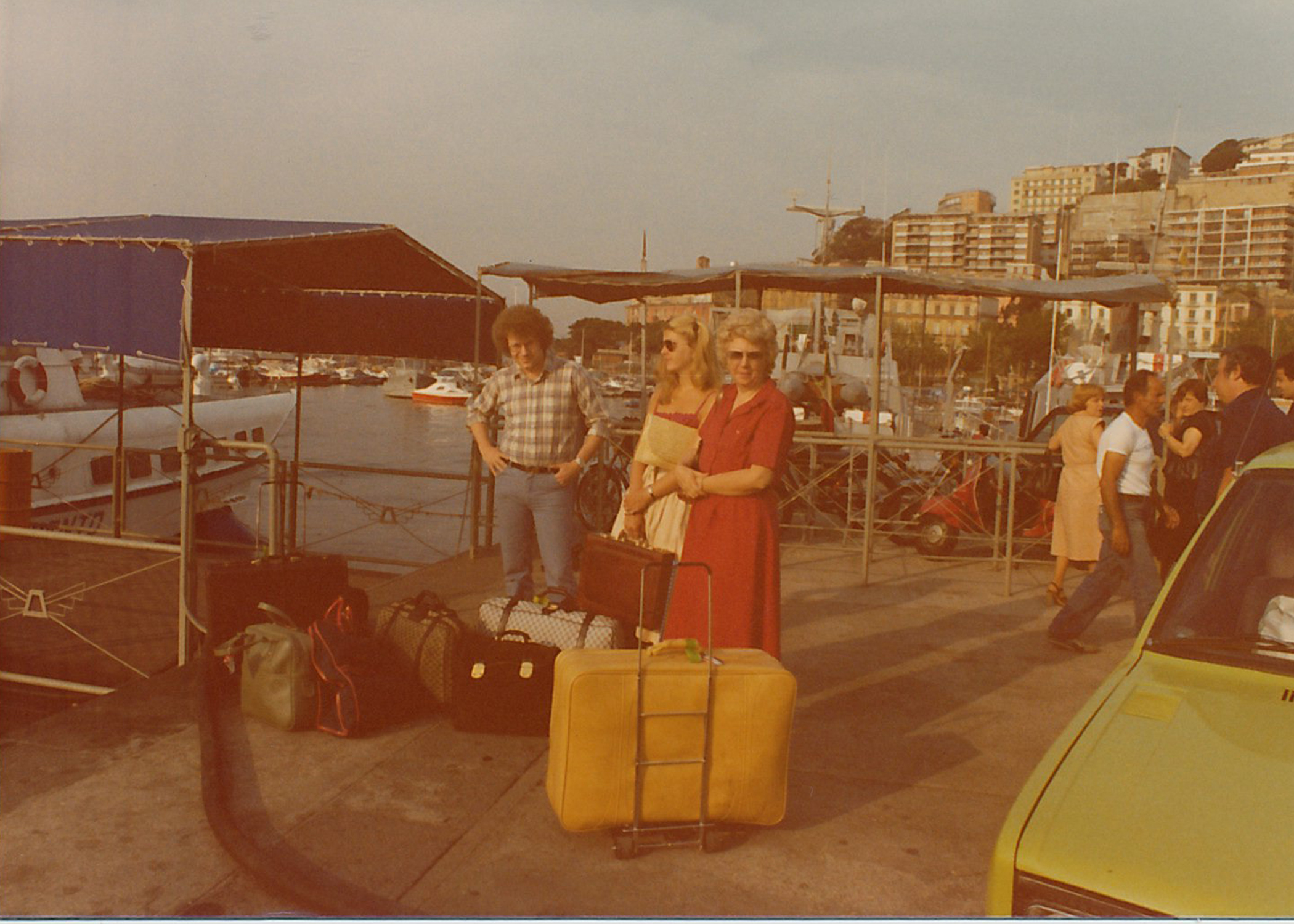 Joan with my parents in Capri, Italy. They packed light for the occasion...ha! Check out the lime green car (Fiat?).