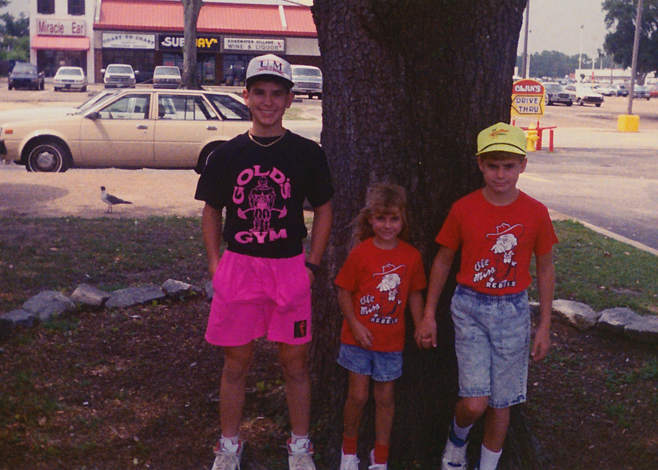 Jonathan and his sister Julie in matching Ole Miss shirts with their cousin Michael.