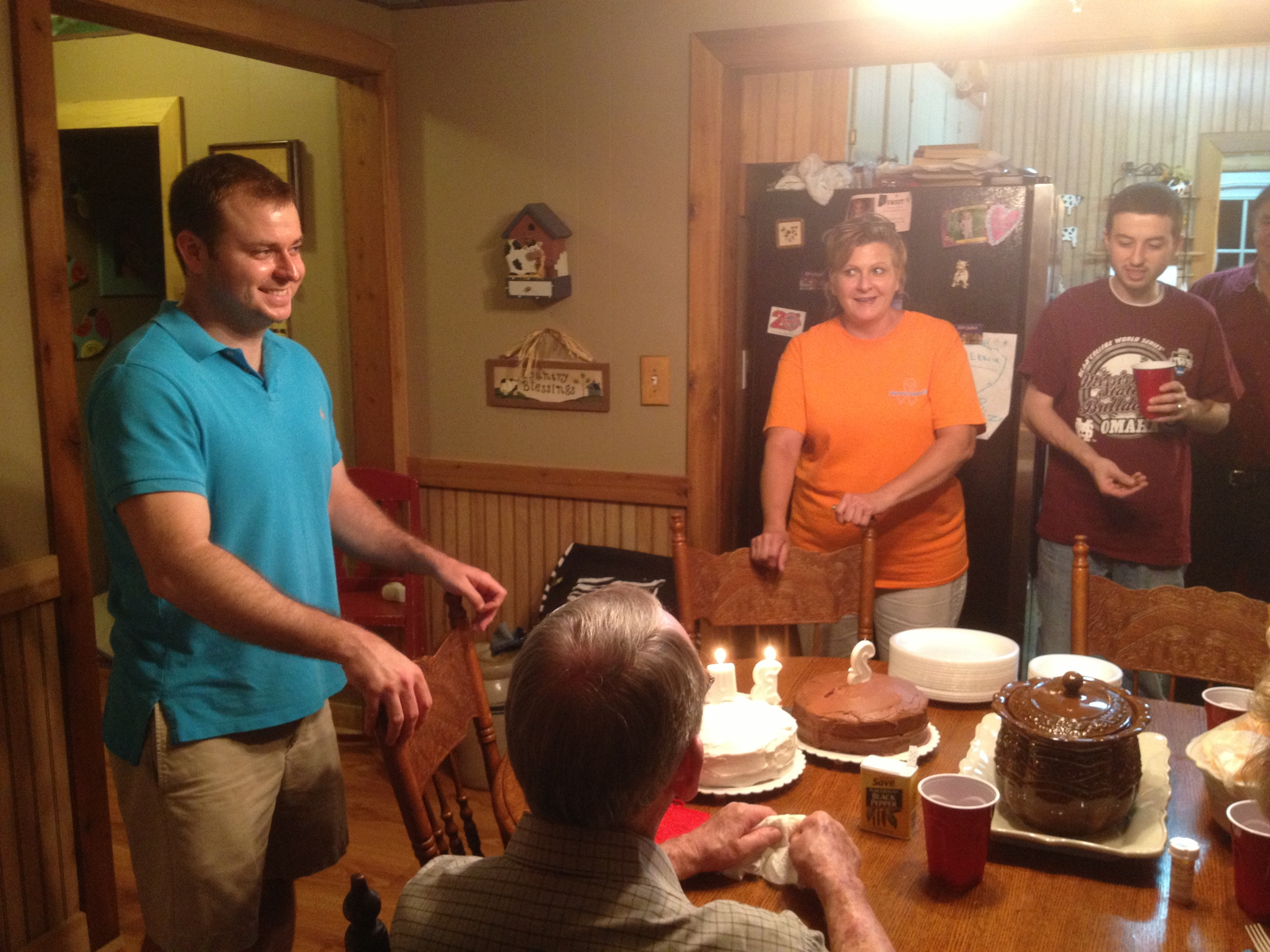 Jonathan celebrating with Gerald, Denise and Josh (and the rest of his family), July 2013.