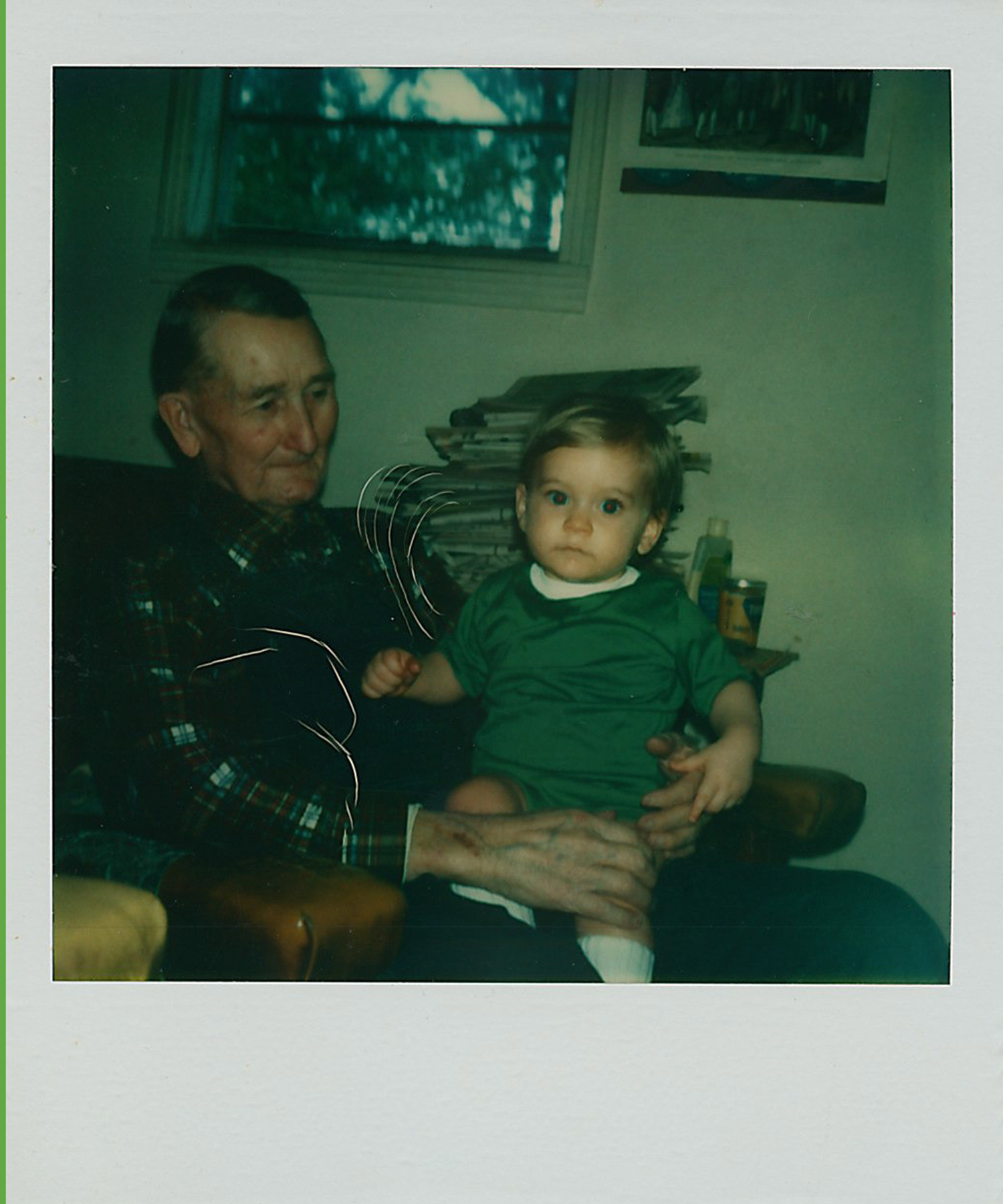 Ten-month-old Jonathan with his great-grandfather Clovis Yates.