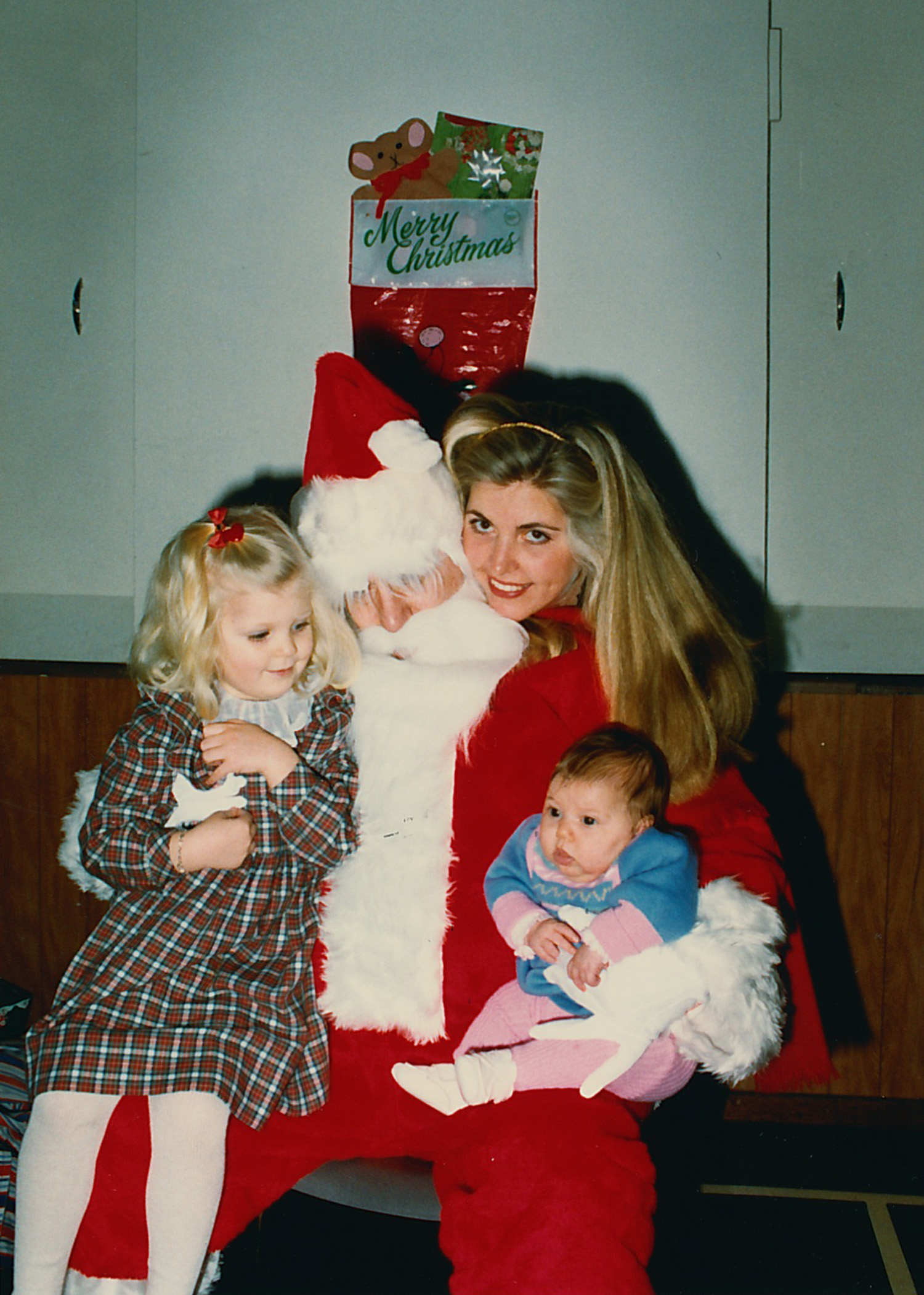 Me with my mom, sister and Santa (my dad).
