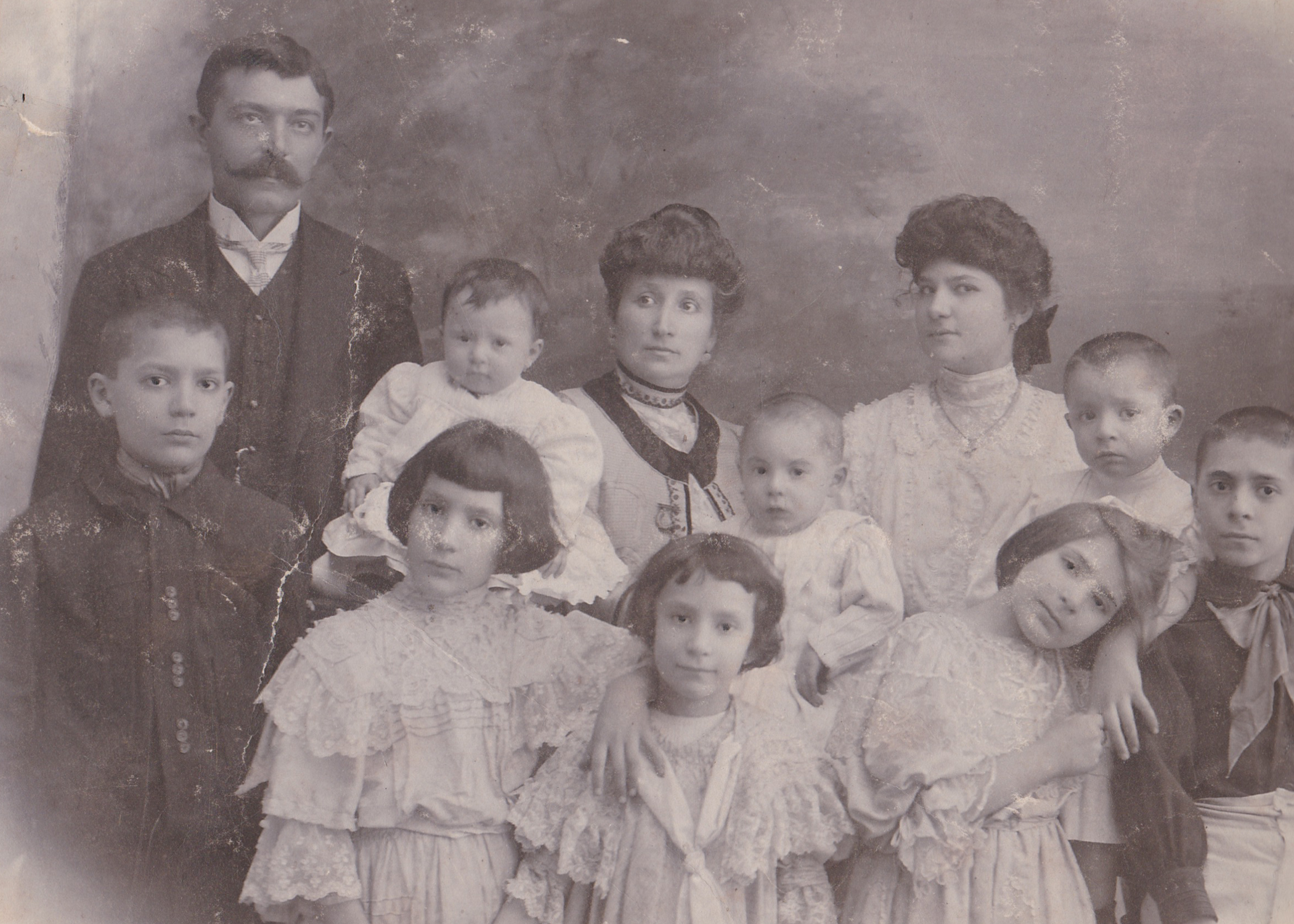 My great-grandmother Tina (front, bottom center) with her siblings and parents.