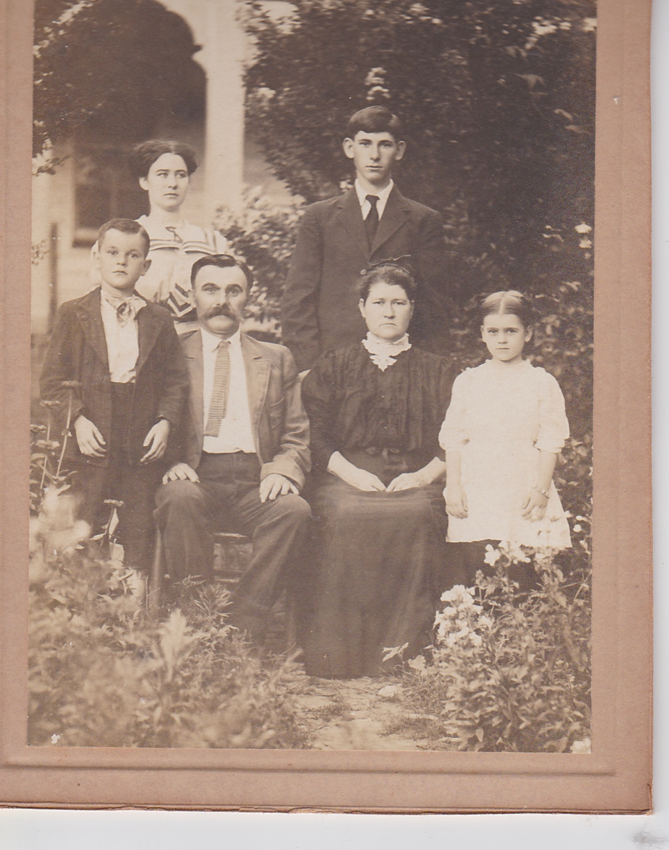 My great-grandmother  Jennie Moore  (back left), her brother Andy (back right), her mother Martha, stepfather Jacob and half-siblings Jake and Mayme Van Bibber.