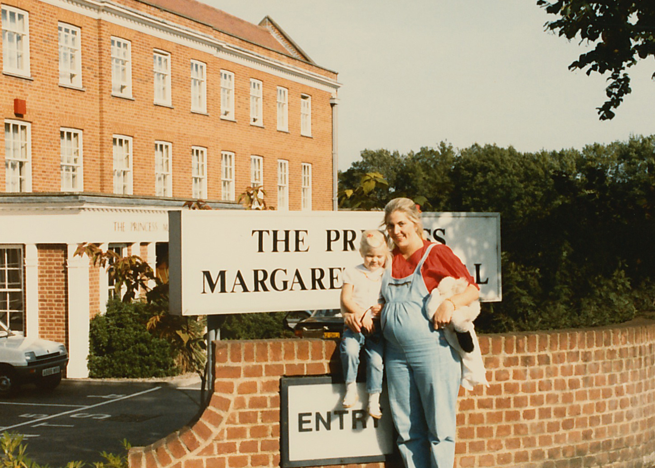 Me, my mother and Lauren as a baby bump in front of the Princess Margaret Hospital in Windsor, England where we were both welcomed into the world.