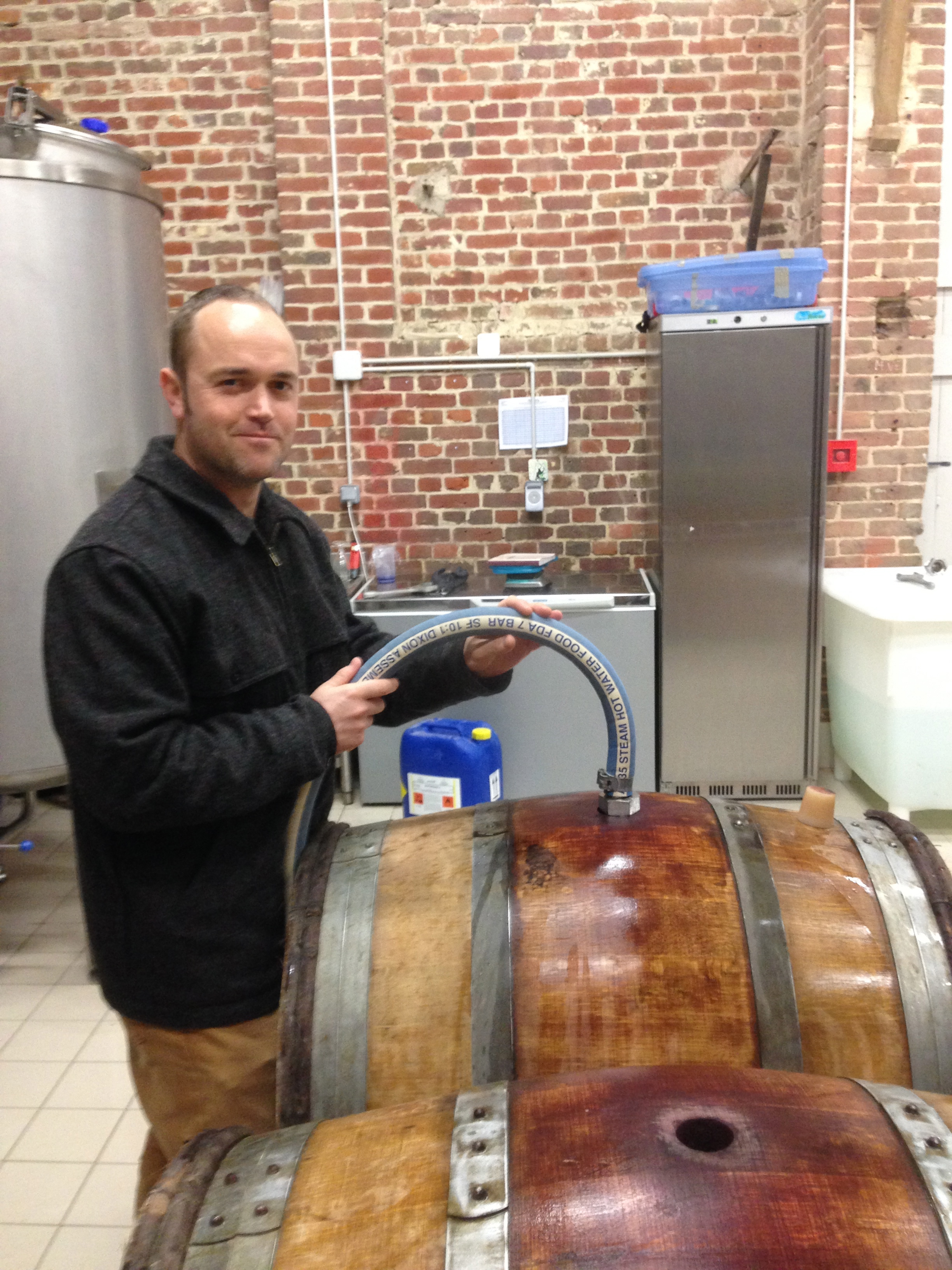 Nick rinsing the casks with hot water and checking for leaks..
