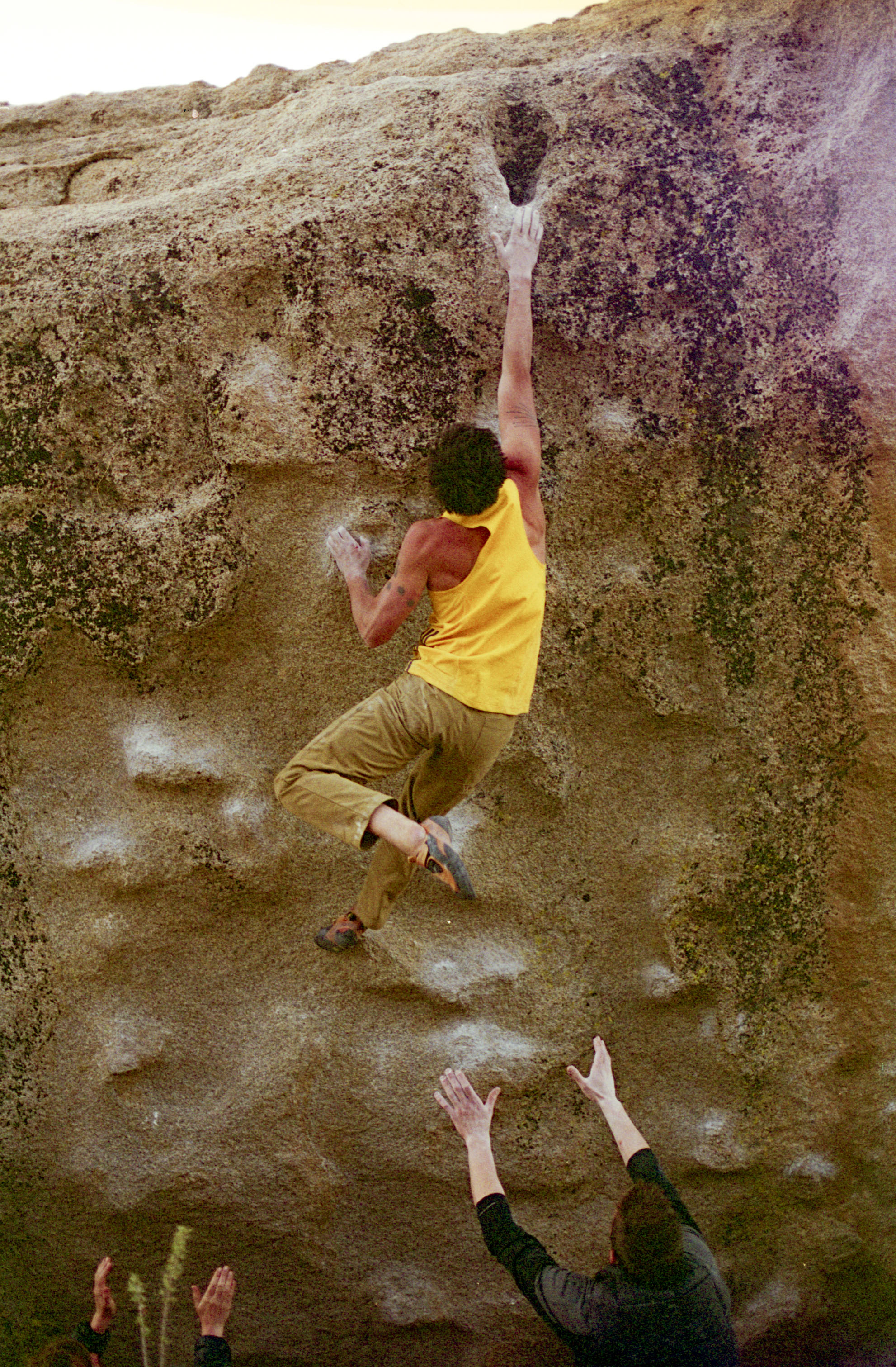 Erik inches away from the final jug on the slope-y classic Seven Spanish Angels, V6, in the Buttermilks.