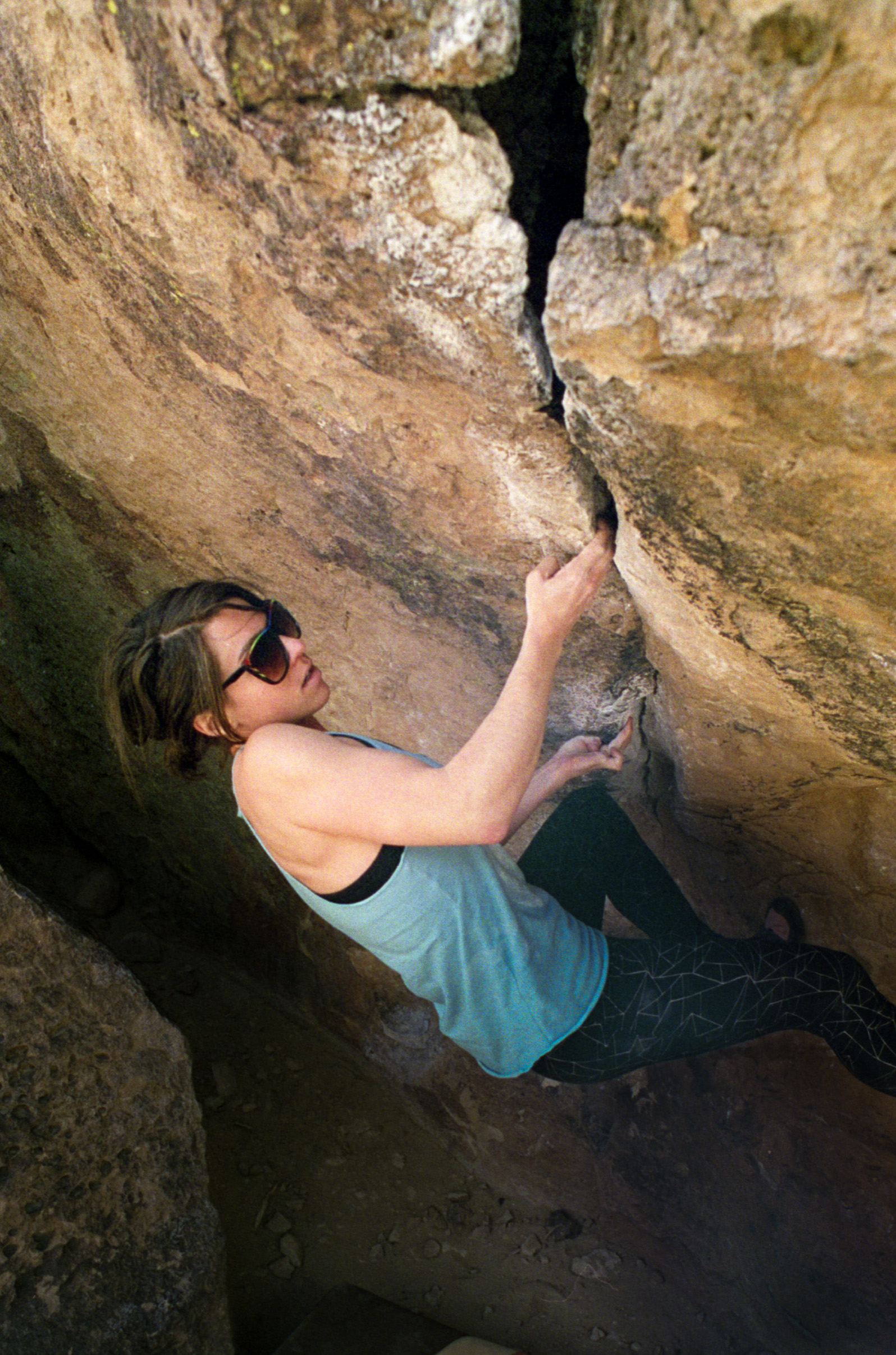 Danielle pulling hard on the Crack Problem, V4, in the Sad's.