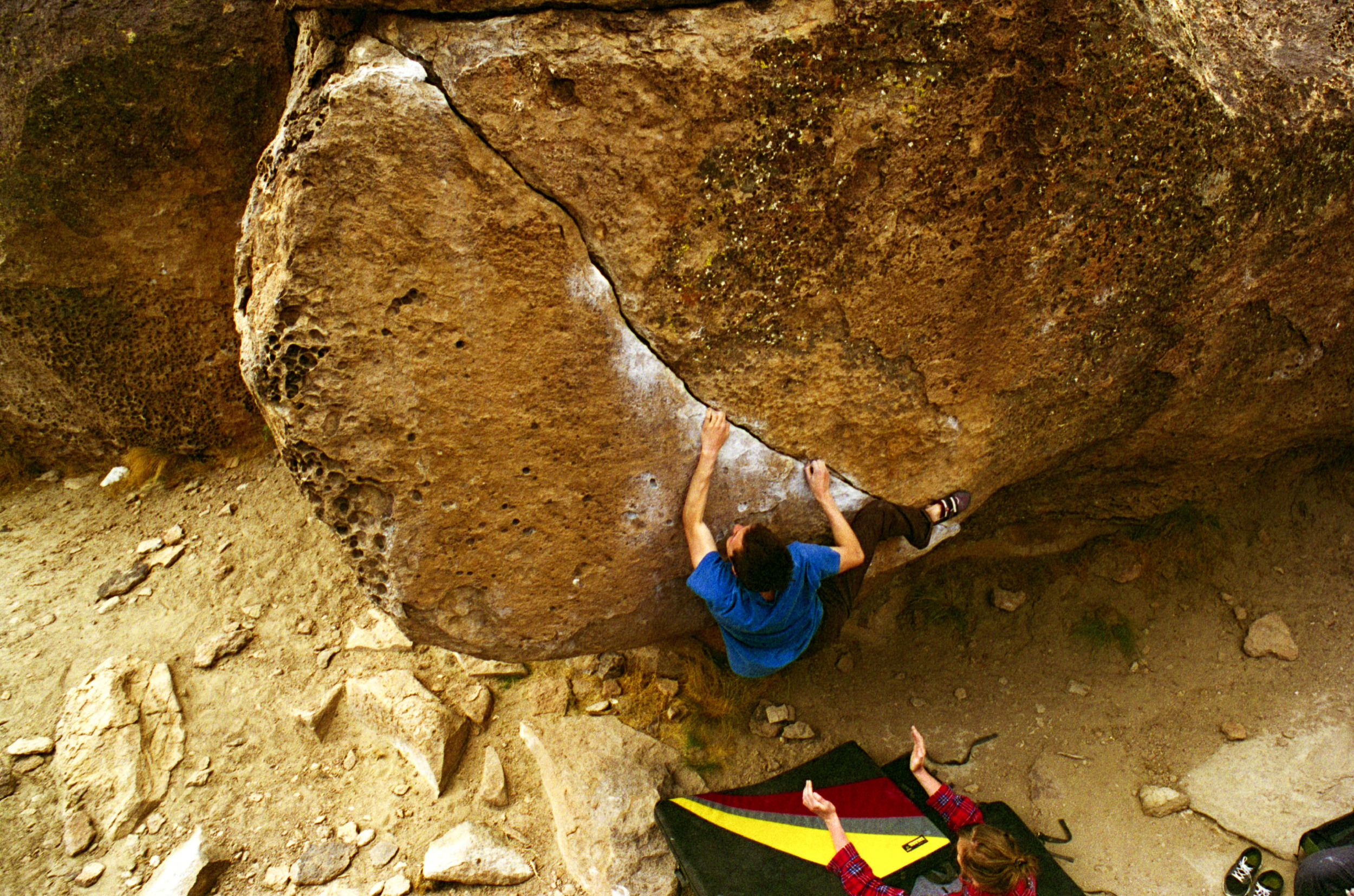 Micah holding on and fighting the barndoor on Rio's Crack, V6, in the Sad's