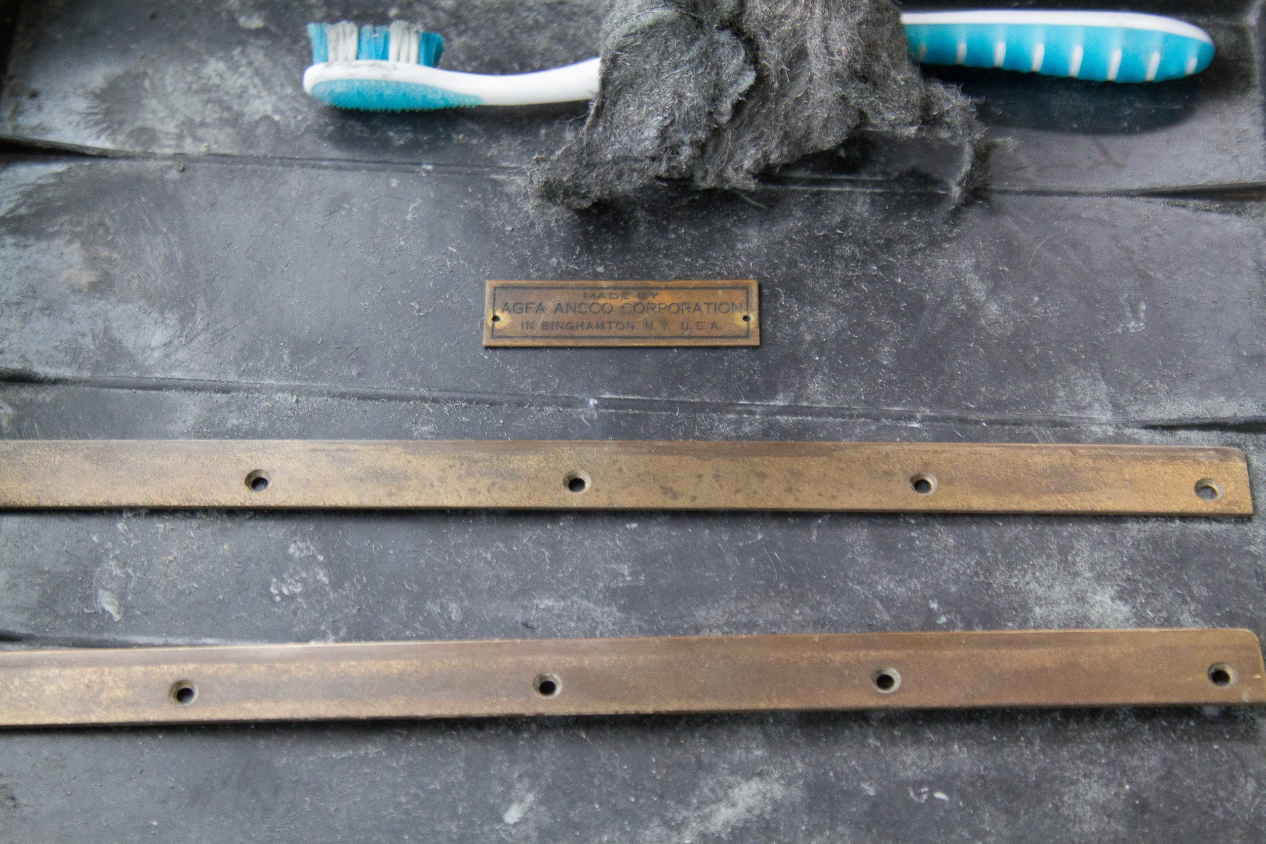 Severely tarnished brass rails