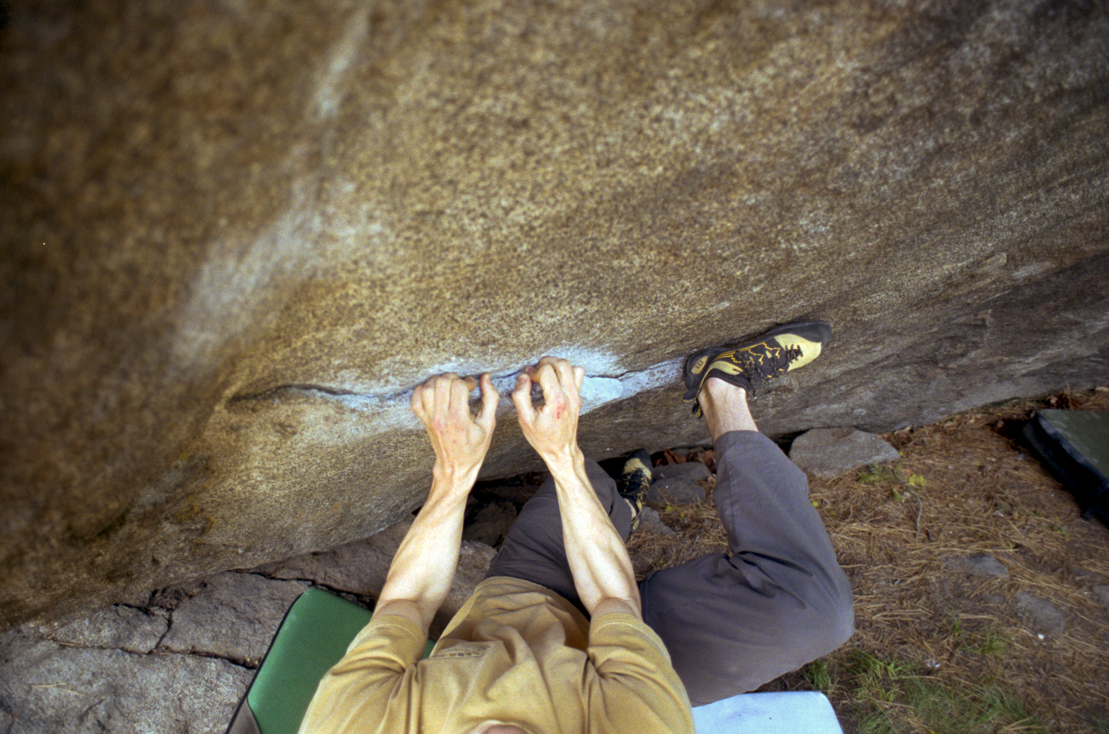 Chris on the starting moves of Busted, V8, in Leavenworth, WA.  Crimp and throw.