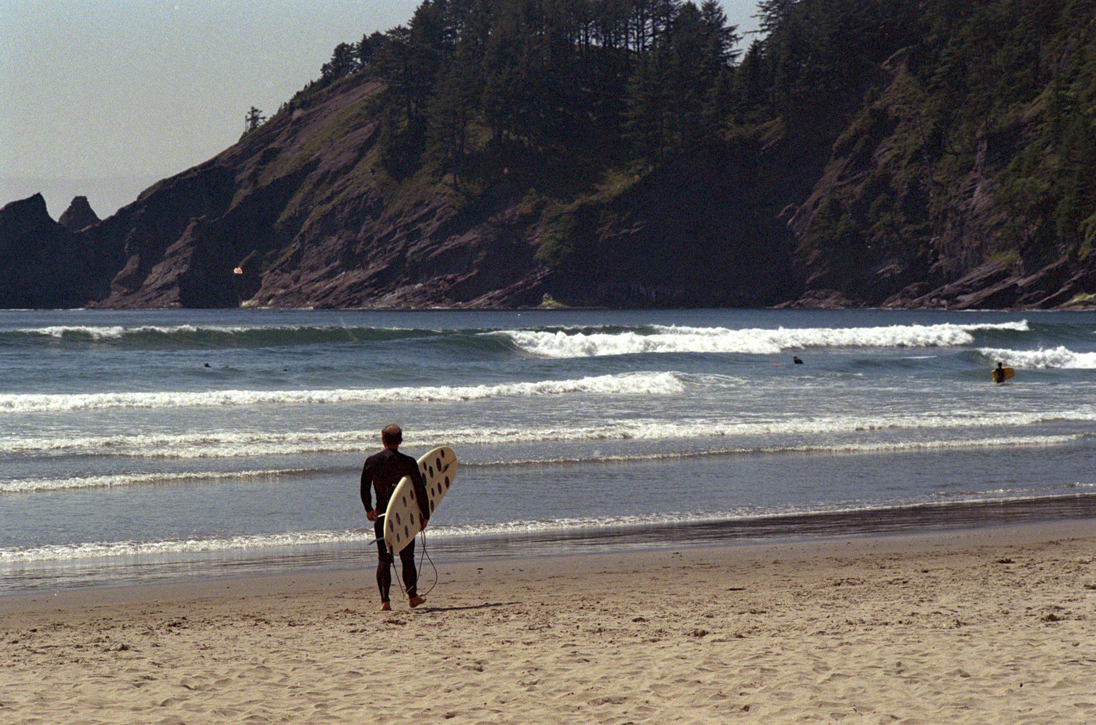 Ryan headed into the surf with the Albino Ladybug surfboard.