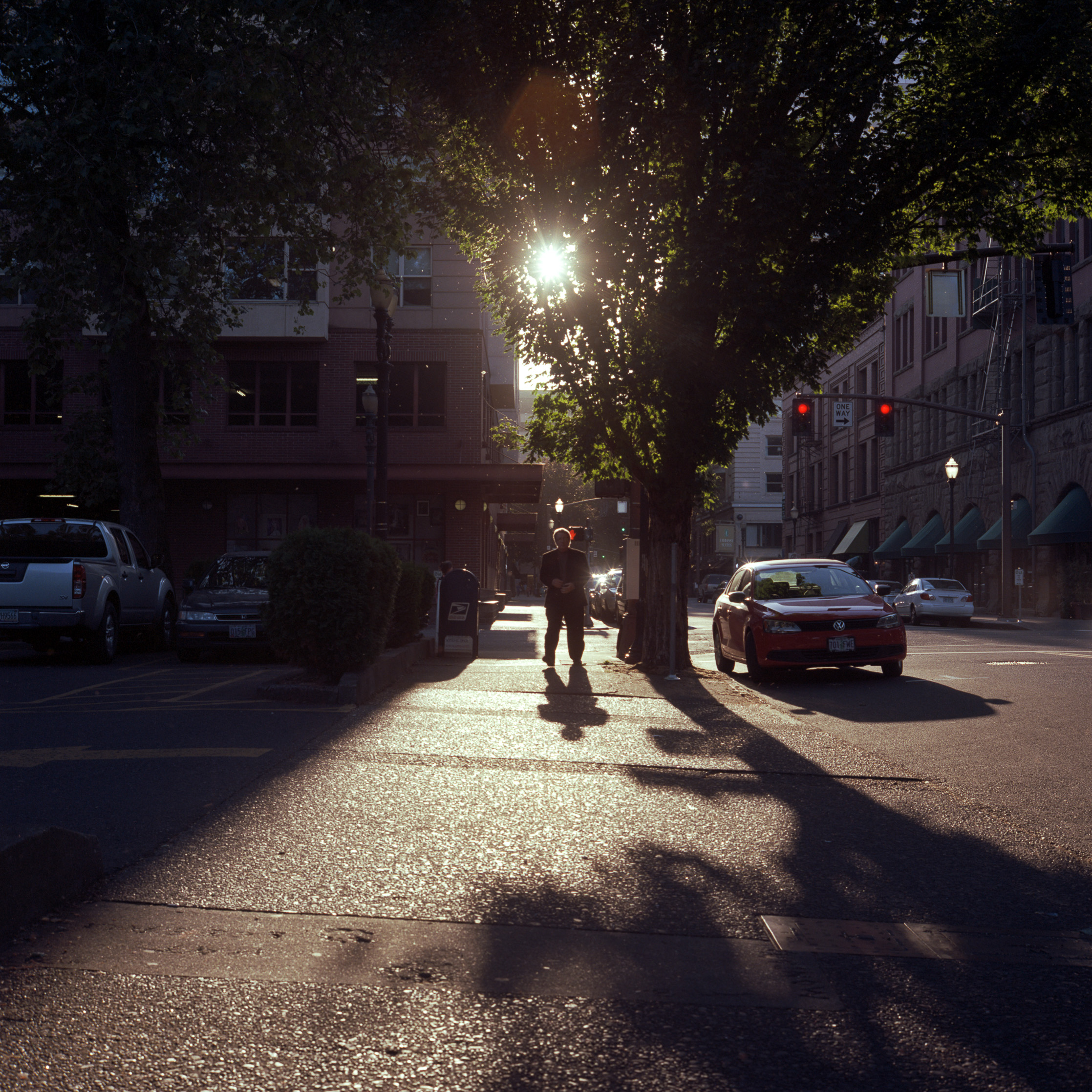 I liked the way the sun was bathing the sidewalk, so I snapped a shot of a gentleman's silhouette as he was walking towards us.