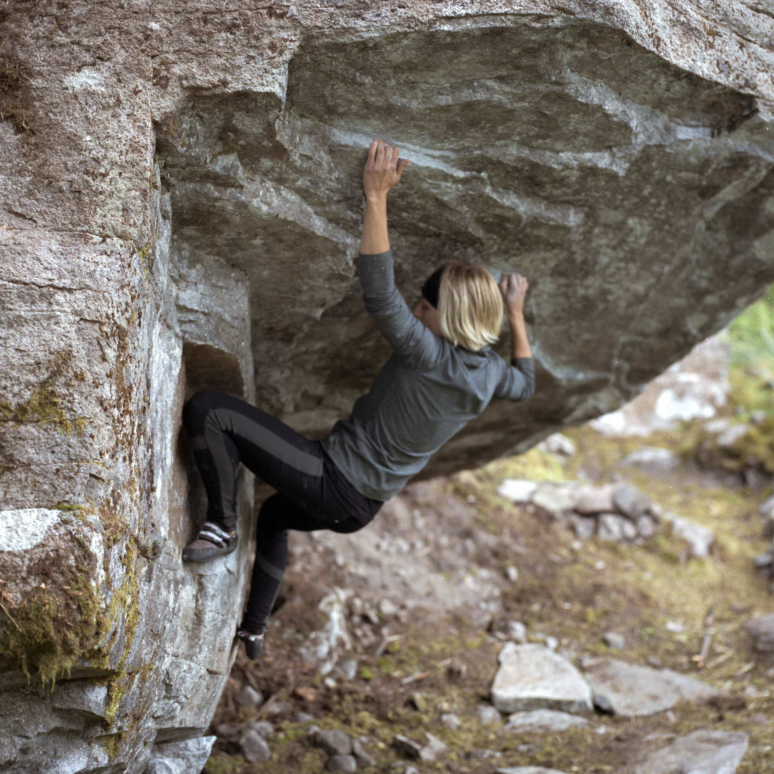 Mary working out the moves on Get Lost, V4 at Lost Lake Boulders
