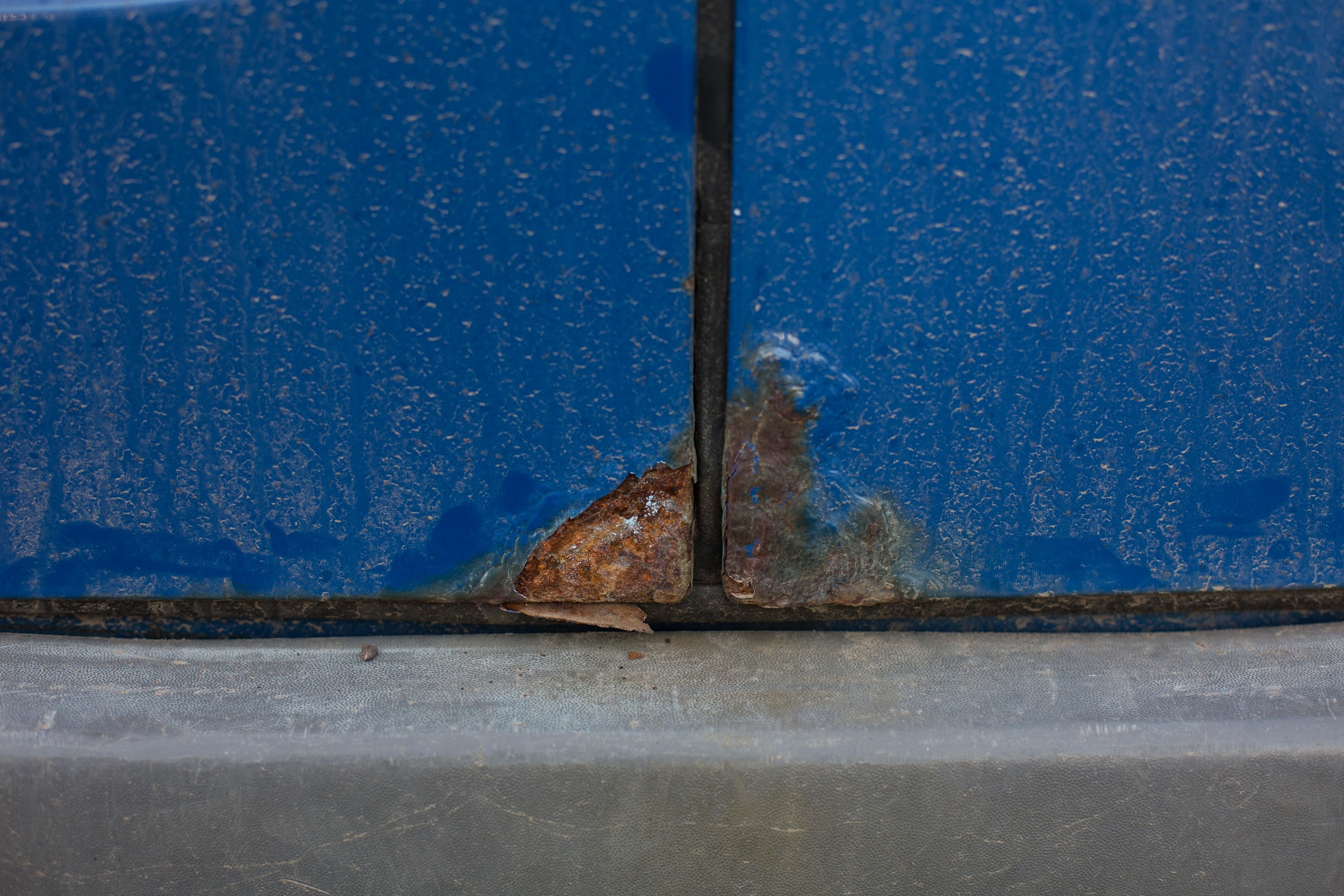 Corners of the rear door. After chipping away at the paint and rust, the metal had been eaten all the way through.