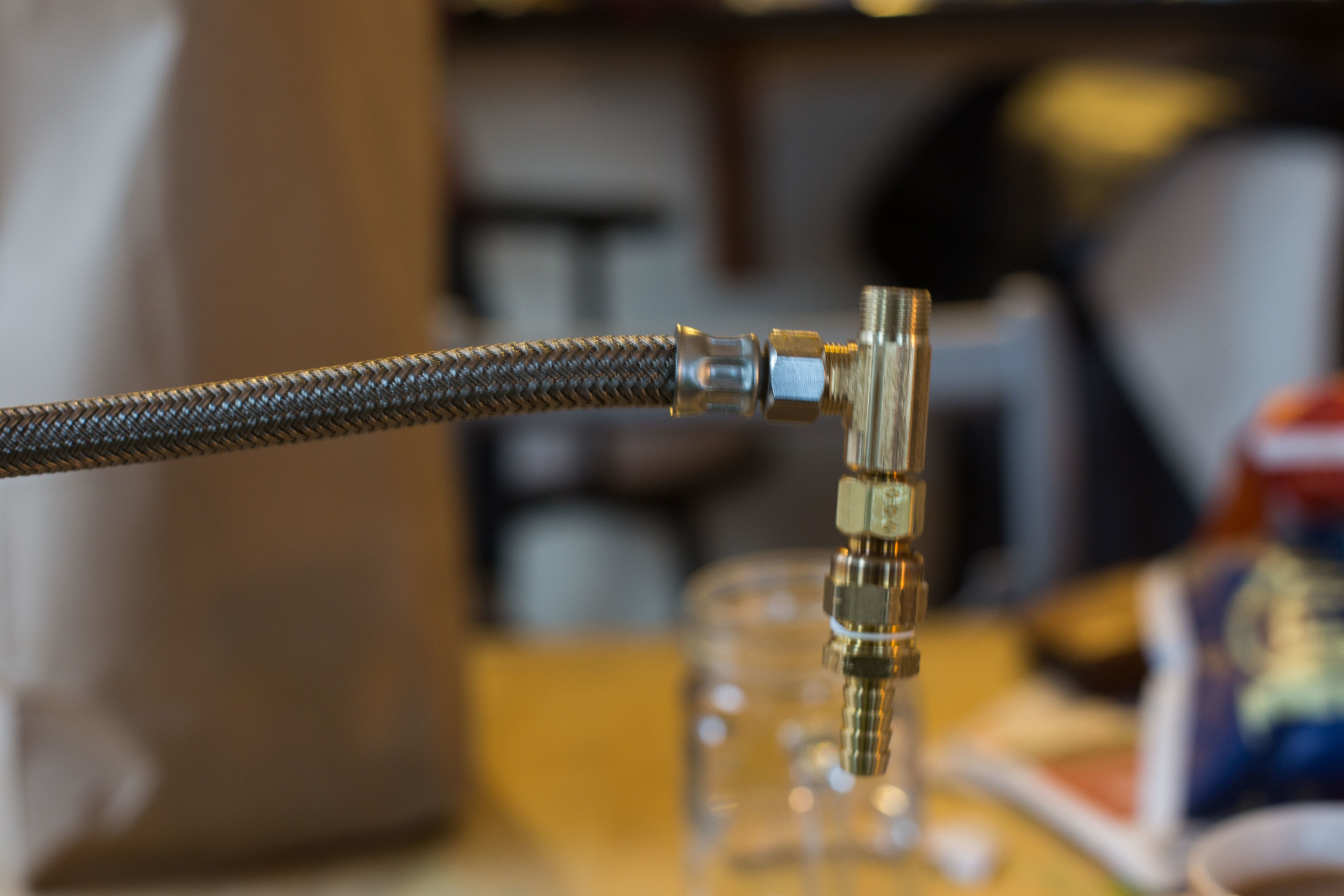 """Compression splitter going into one faucet line. The other screws on top. Bottom connection is a hose fitting, which is connected to a 3/8"""" barb."""