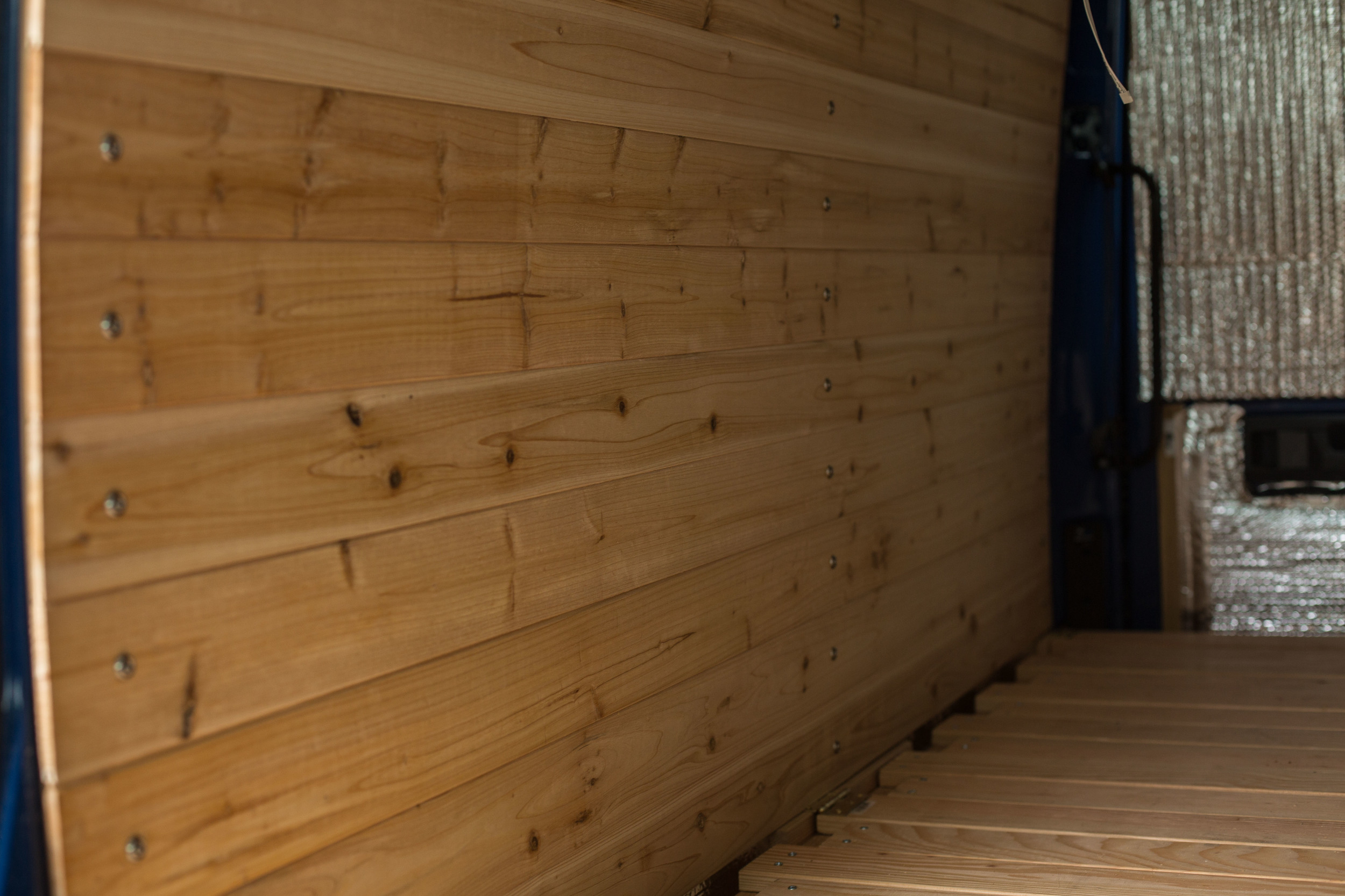 Cedar paneling above the bed