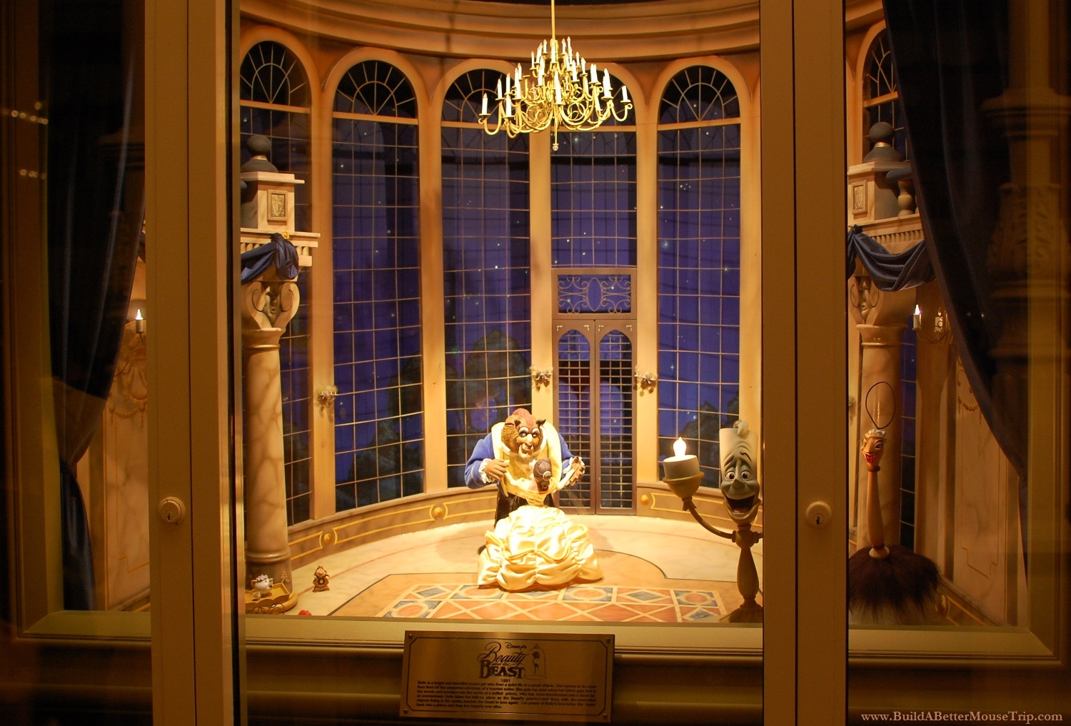 Beauty and the Beast window display in the Emporium gift shop on Main Street USA in the Magic Kingdom at Disney World.