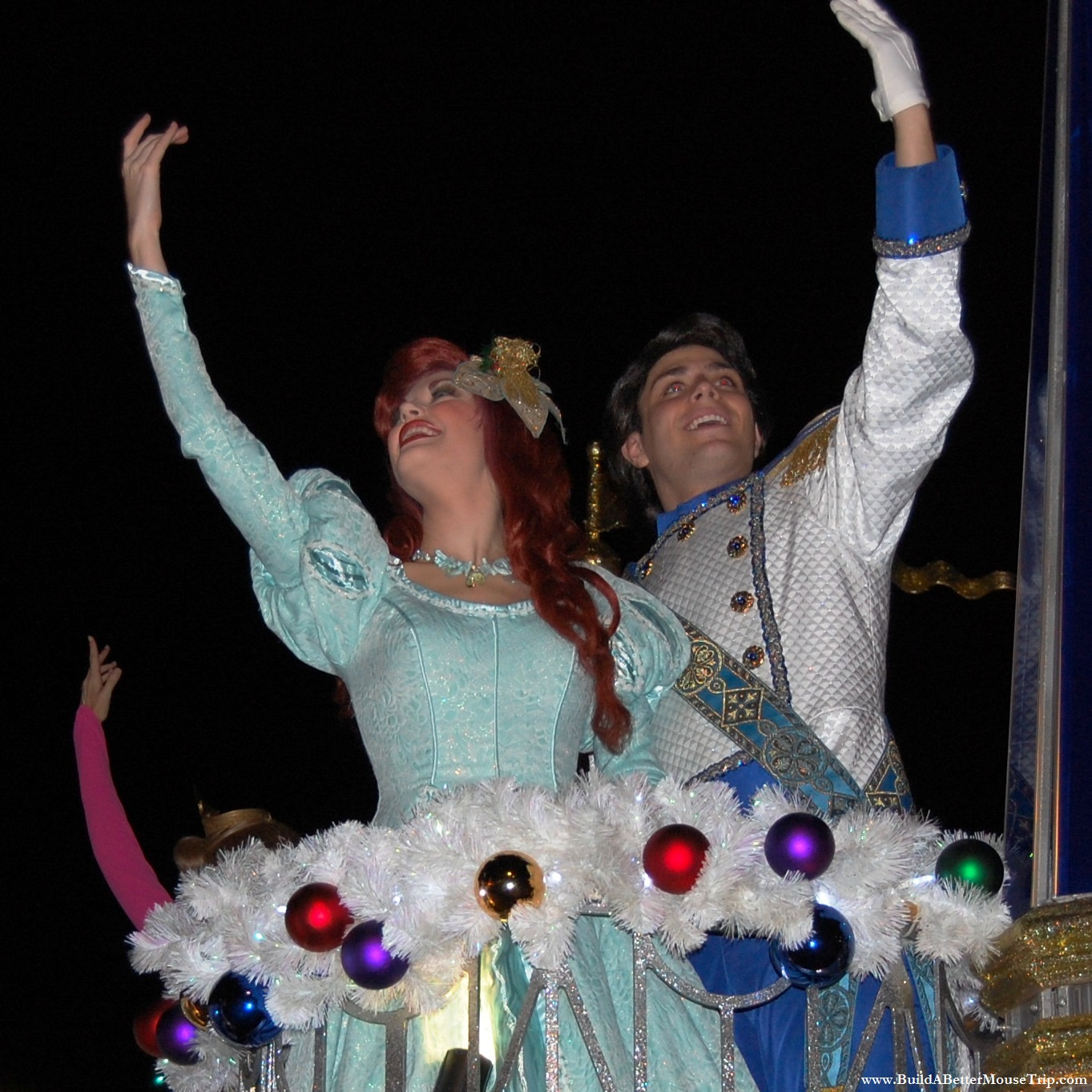 Ariel and her prince in the Once Upon a Christmastime Parade at Mickey's Very Merry Christmas Party at Disney World.