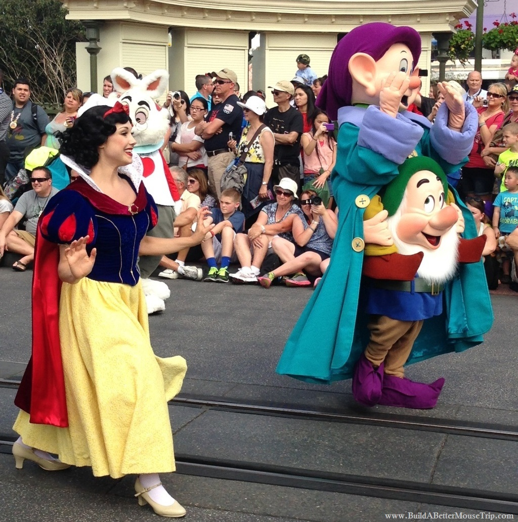 Snow White and the Seven Dwarfs in the Festival of Fantasy Parade in the Magic Kingdom at Disney World.