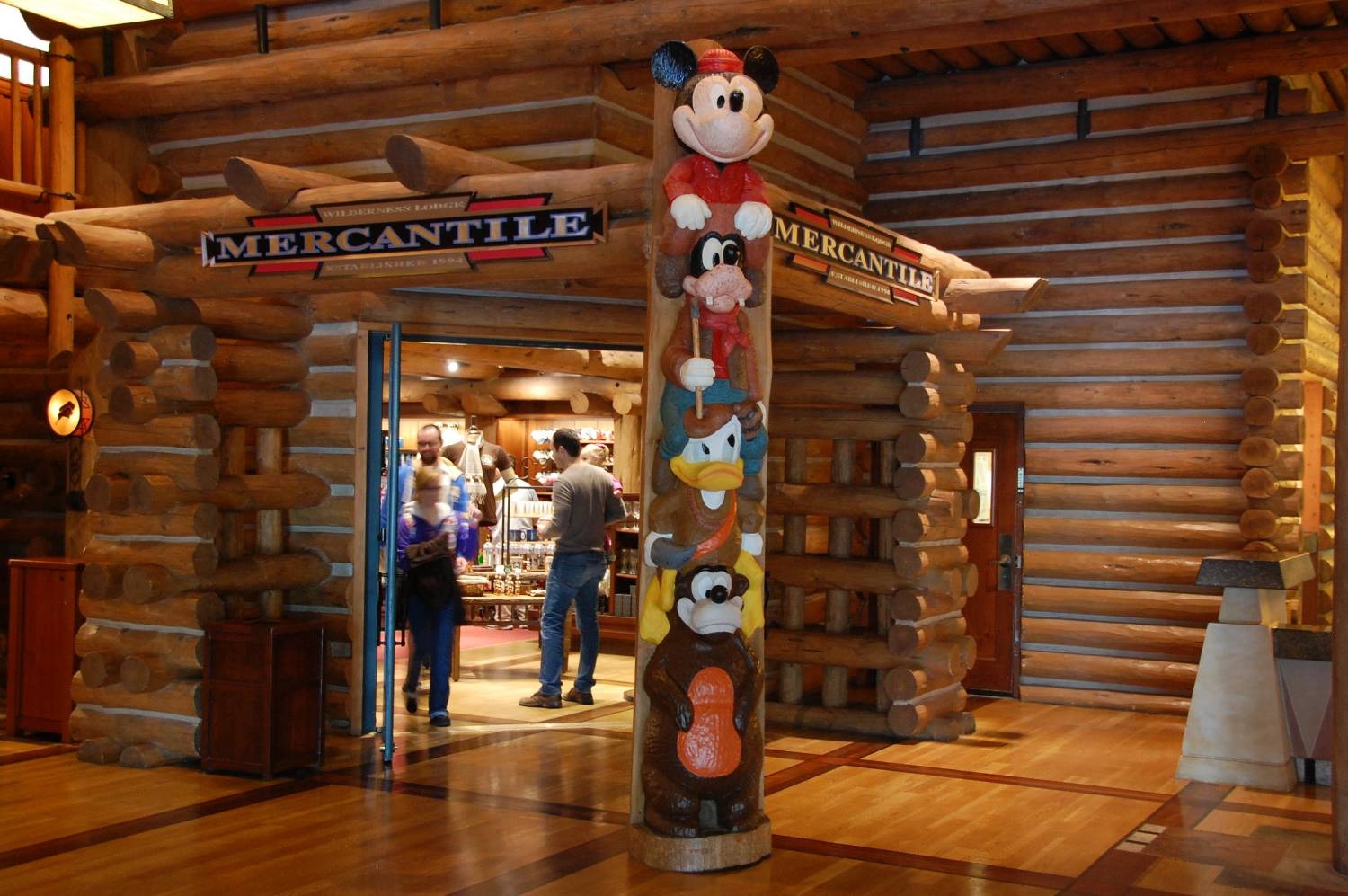The Mercantile in the lobby of Disney's Wilderness Lodge features a Disney character totem pole.